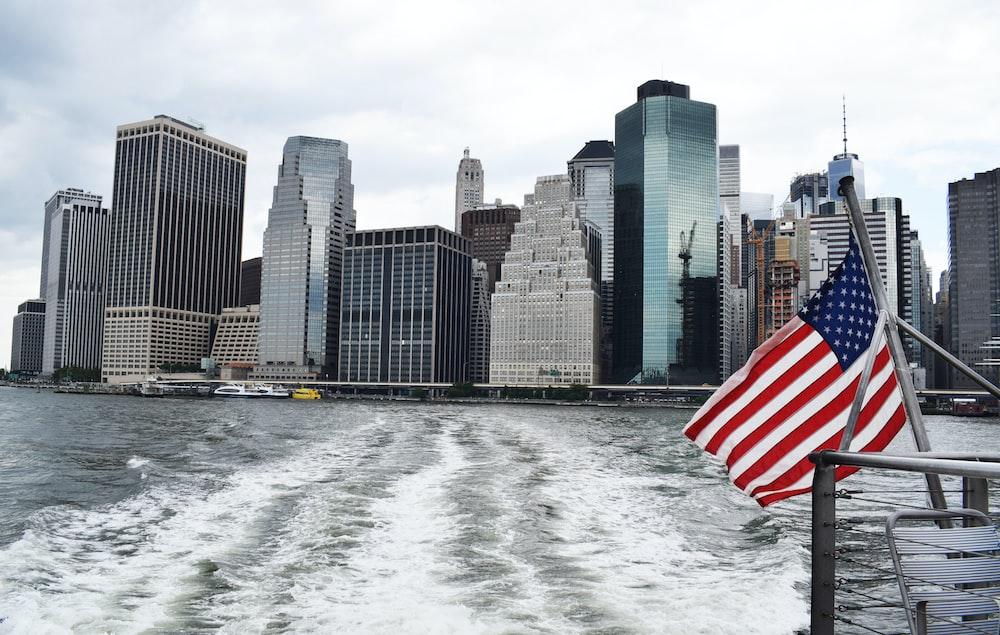 U.S.A. flag on boat near city