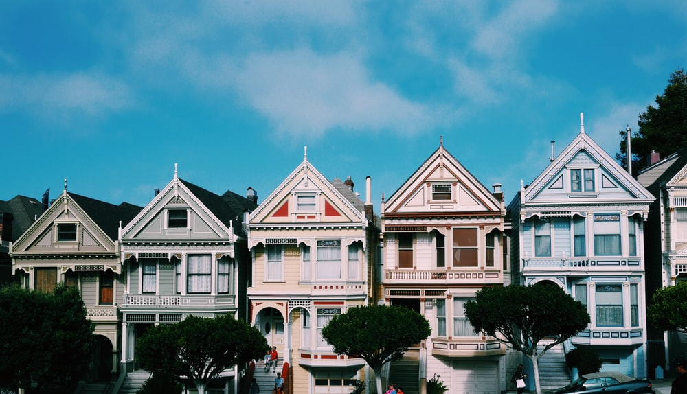 five assorted-color 2-storey houses