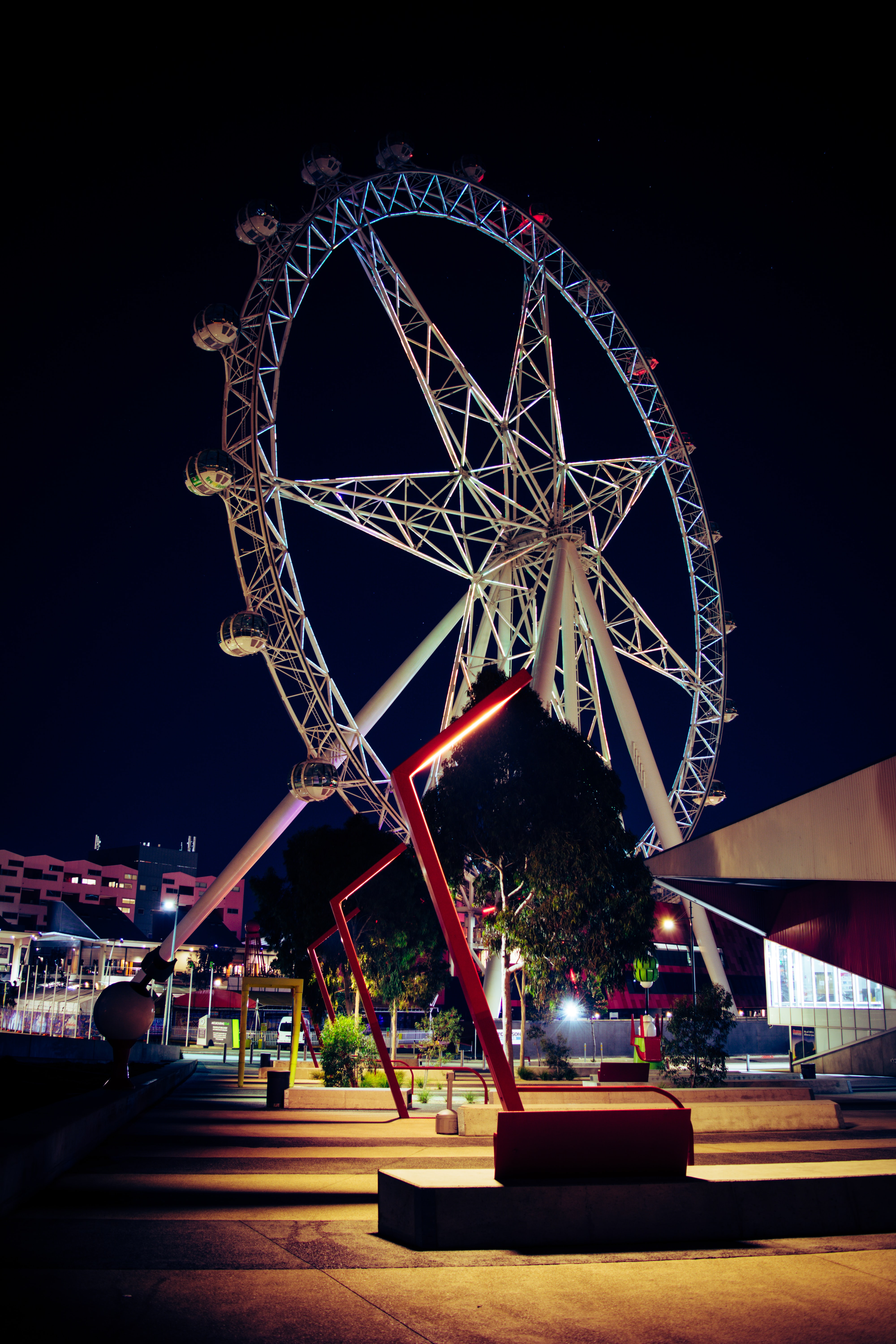 low angle photo of white and red ferris wheel