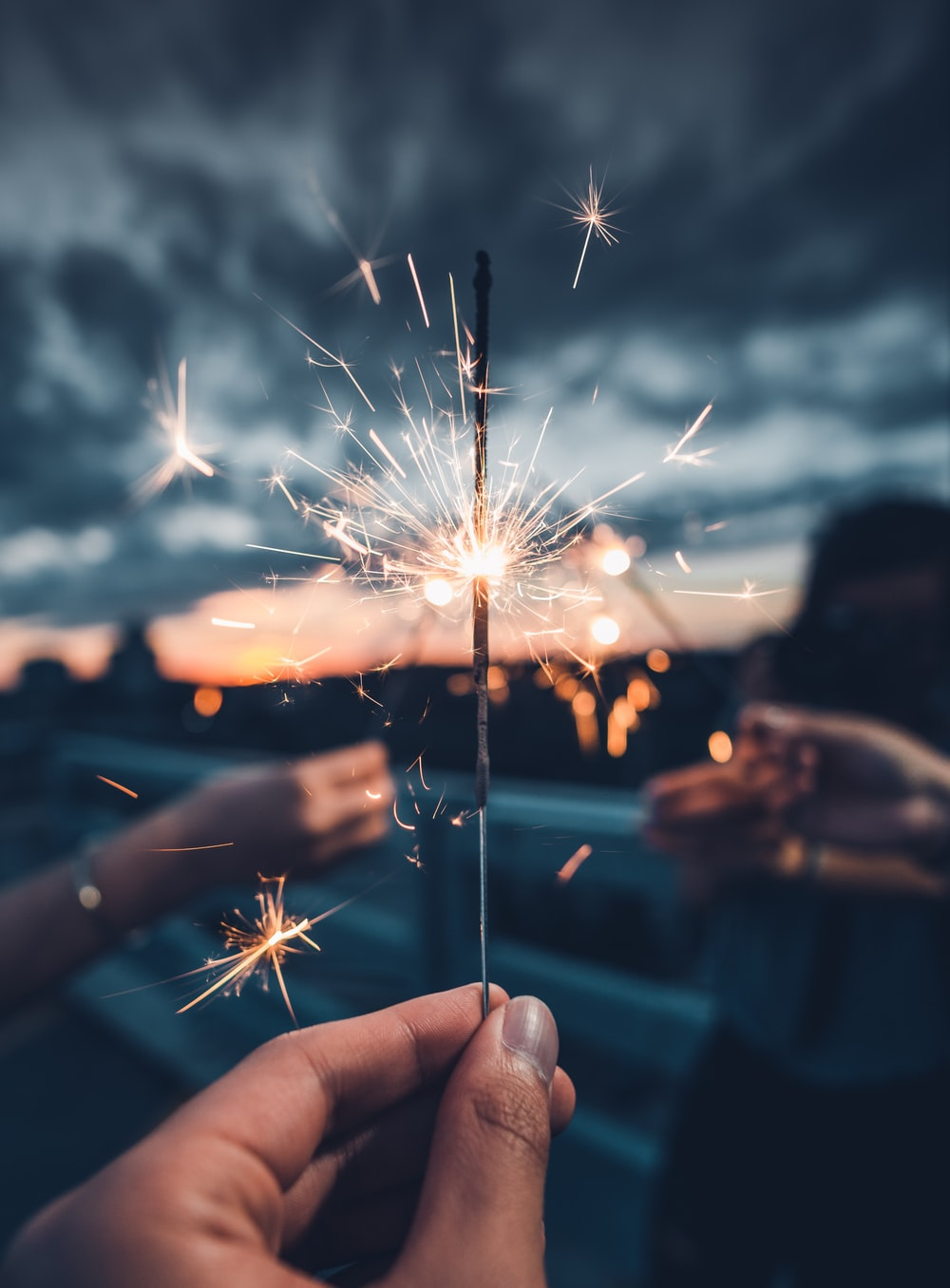 photo of person holding lighted sparkler photo - Free ...