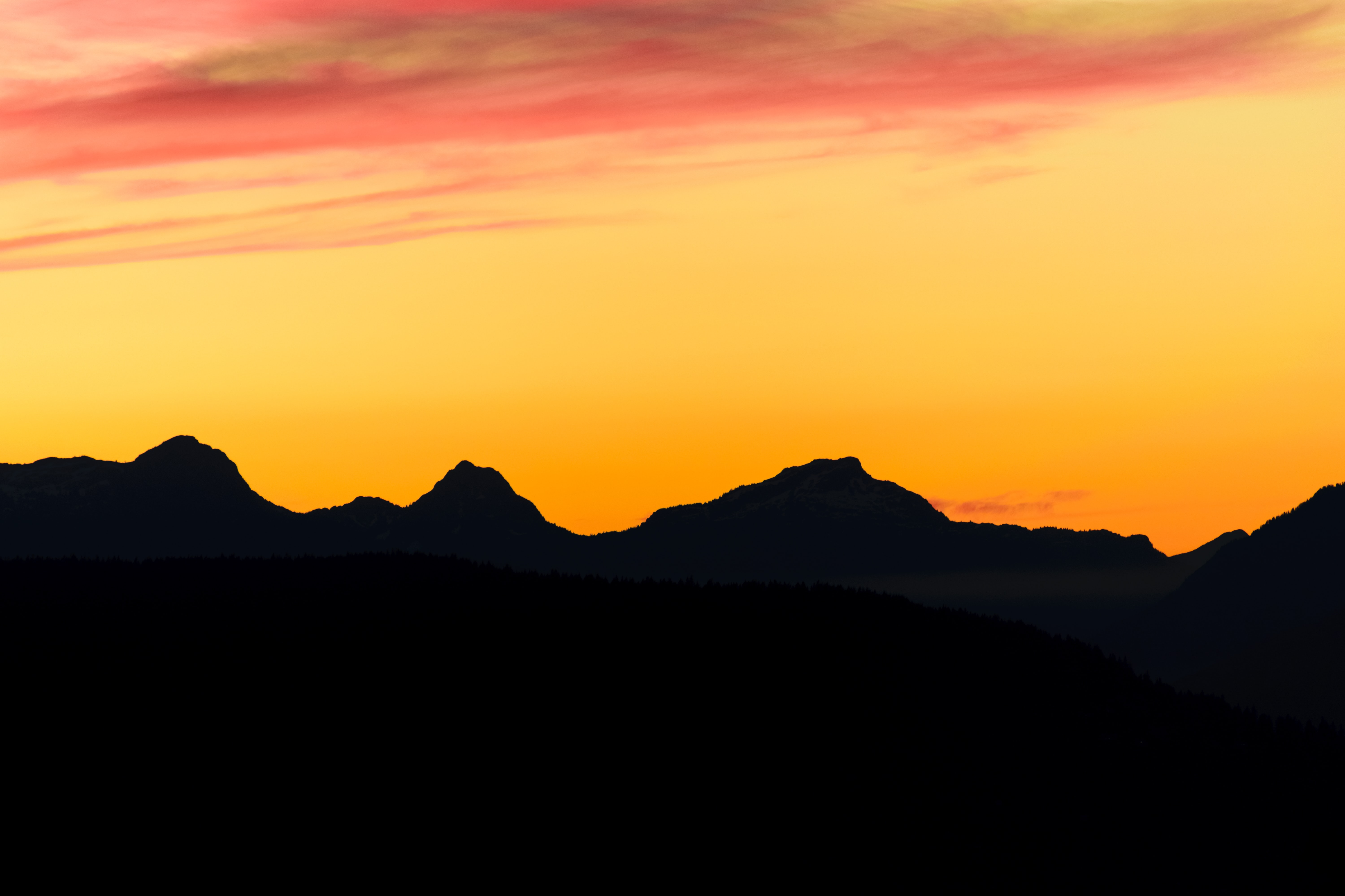 silhouette photography of mountains underneath golden hour