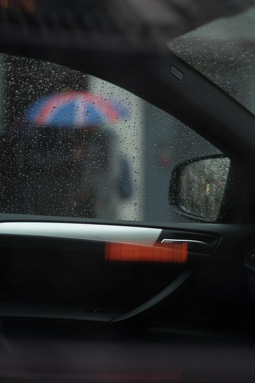 black automotive door with water droplets