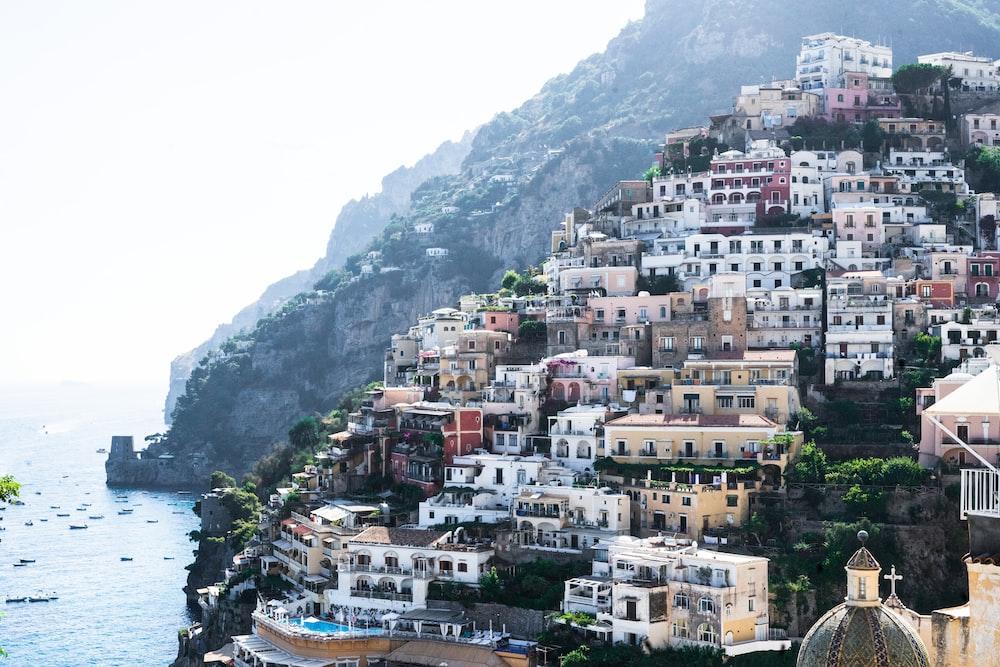 photo of houses near ocean during daytime