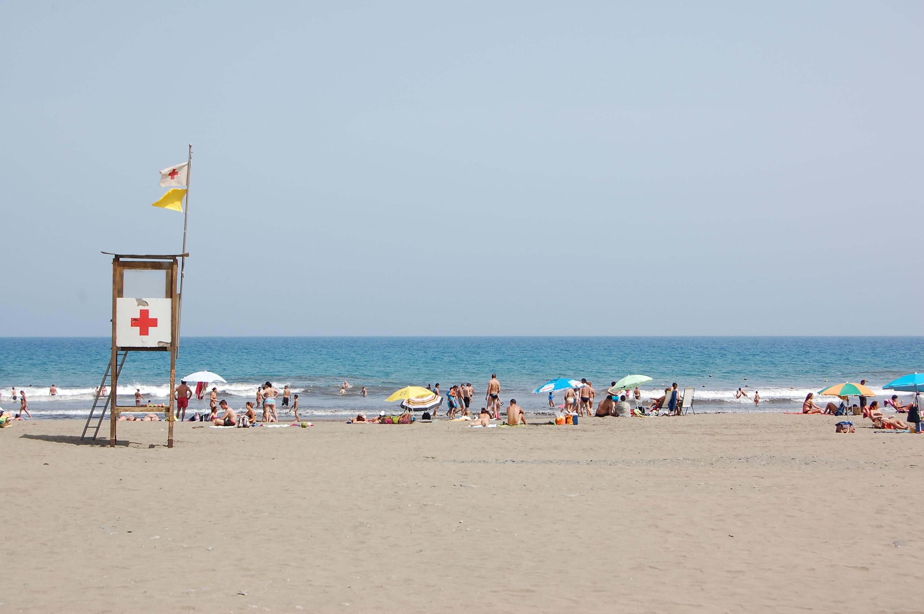 Lifeguard tower on crowdy sand beach in Gran Canaria