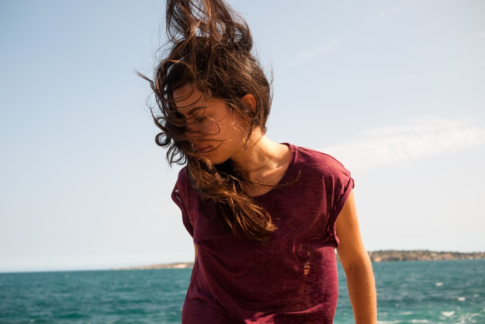 woman standing while her hair is blown