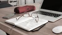 """Laptop glasses notebook desk"""