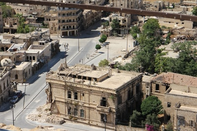 high-angle photography of beige concrete building syria teams background