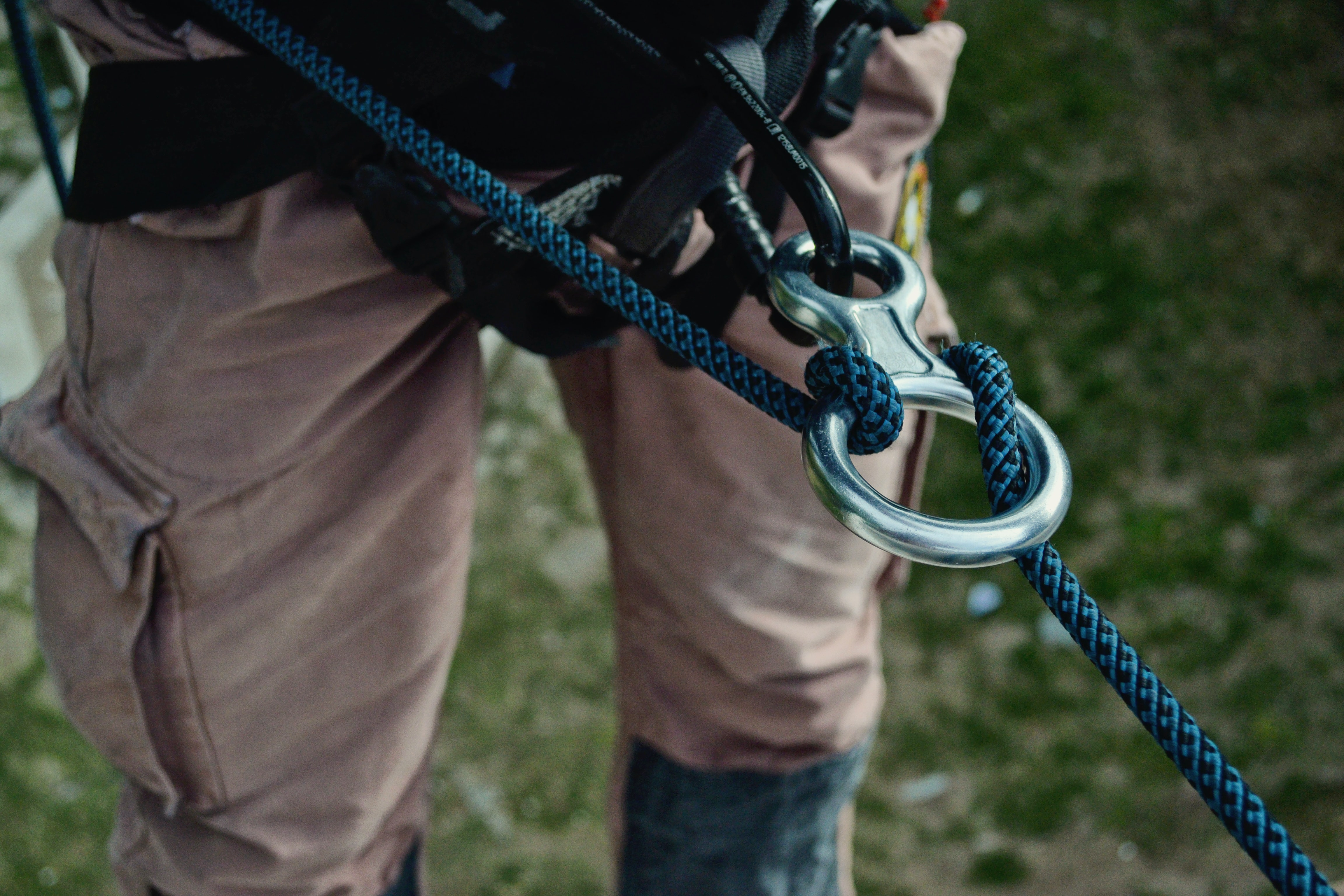 Macro shot of details on a climber's rappel and harness