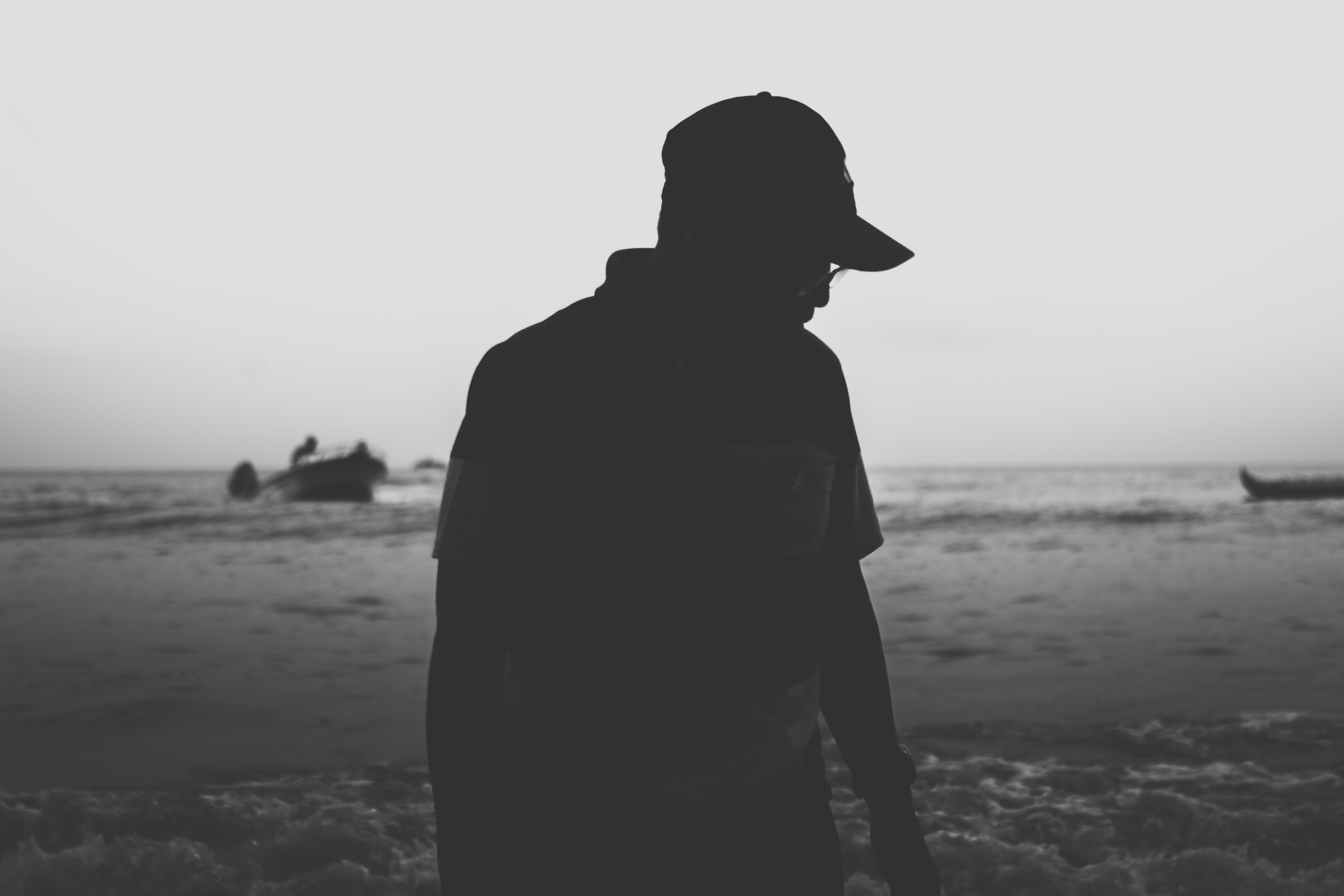 silhouette photo of person in cap
