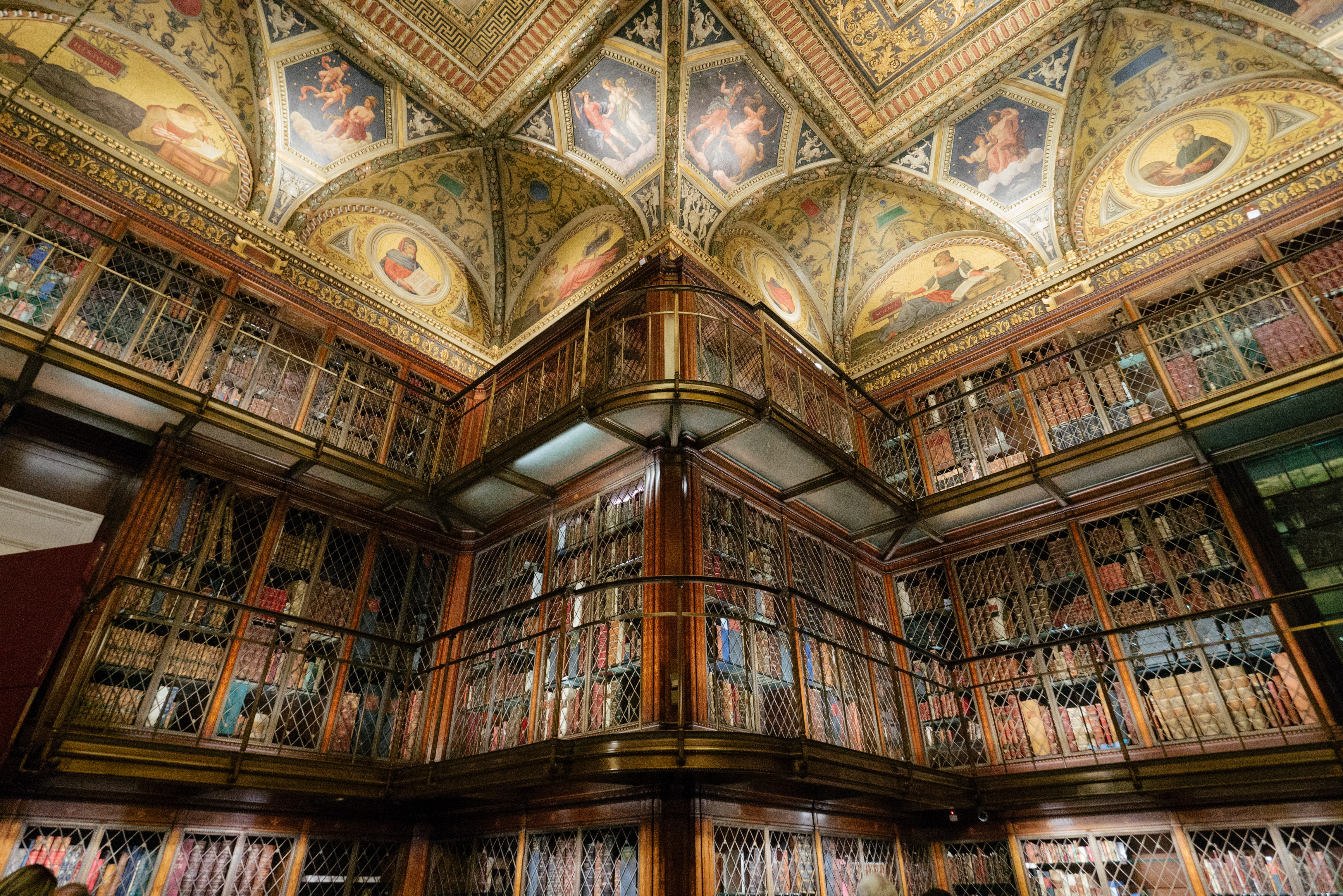 Shelves of books and ornate, historic ceiling architecture in The Morgan Library & Museum