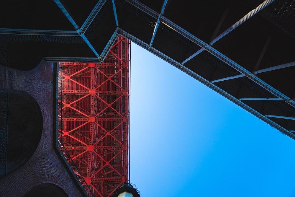 red metal trusses taken at daytime