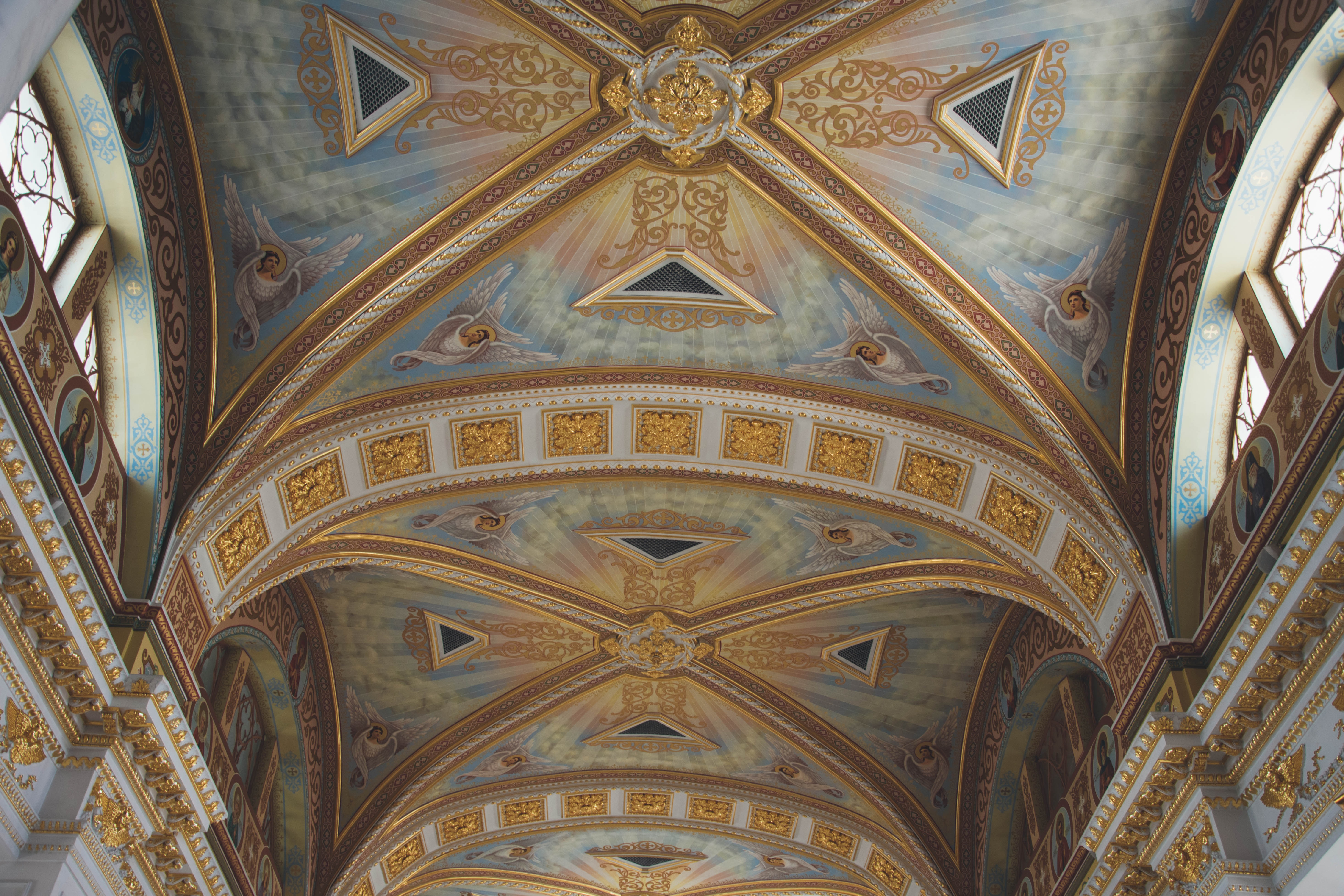 Cathedral church ceiling in Odessa with beautiful artwork and gold architecture