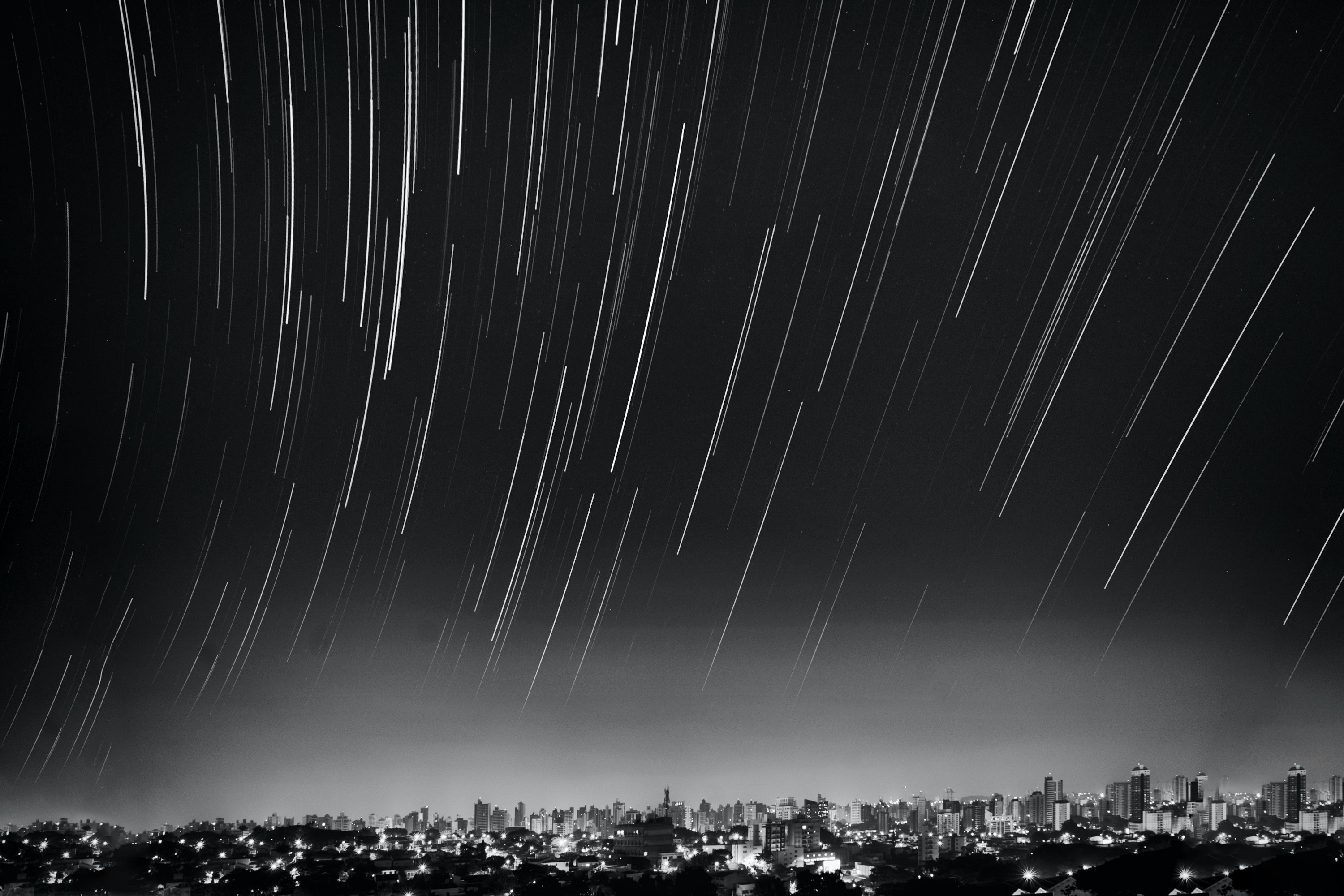 grayscale photo of meteor shower