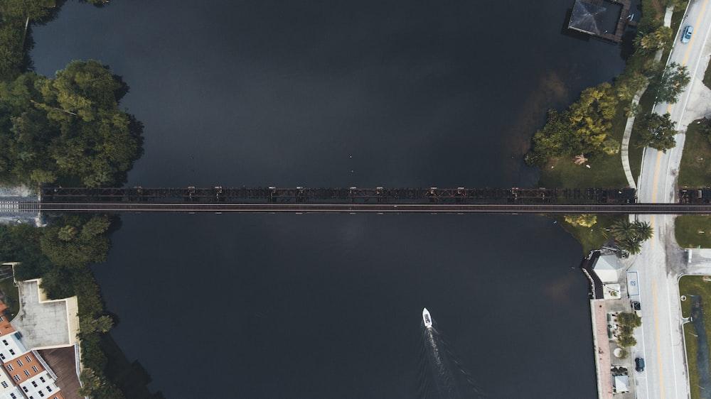 aerial view of black suspension bridge