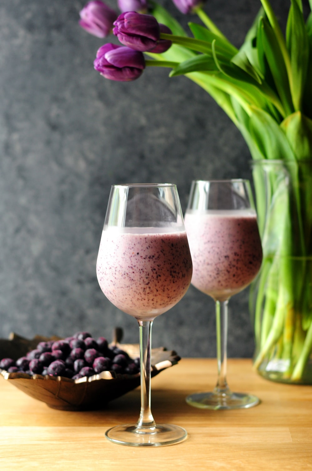 two berry shake on drinking glasses
