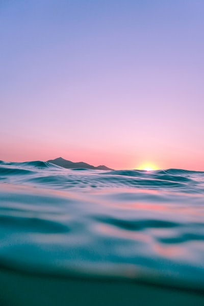 calm body of water during golden hour