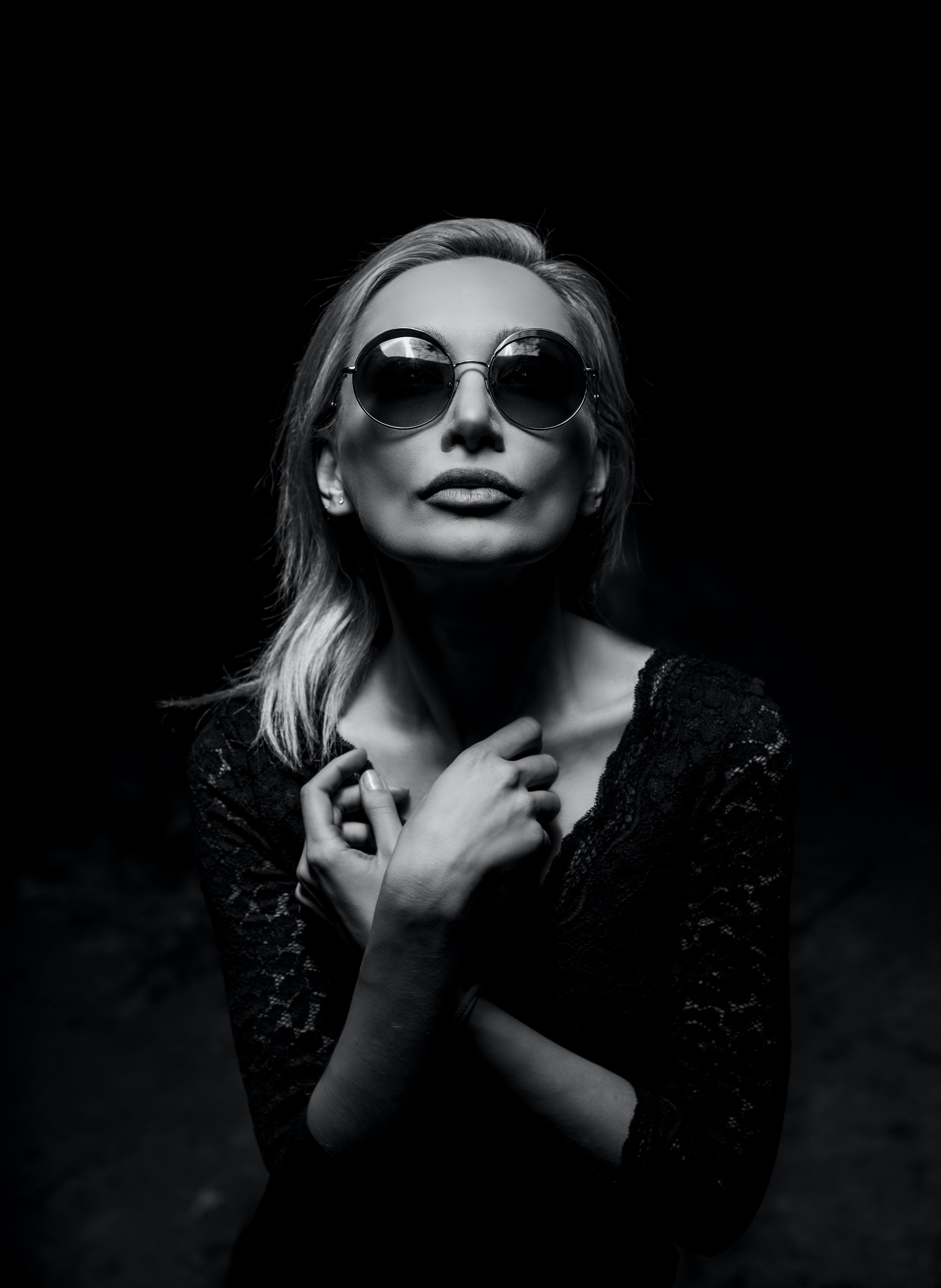 Black and white shot of attractive blonde woman in round sunglasses posing, Tehran Province