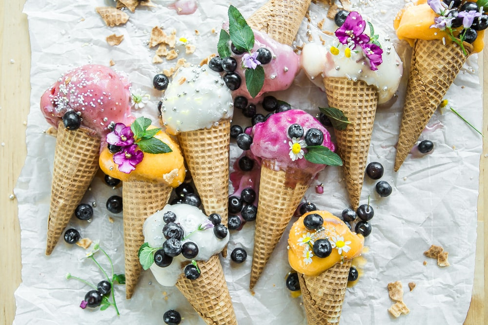 coned ice cream with blueberries and flowers