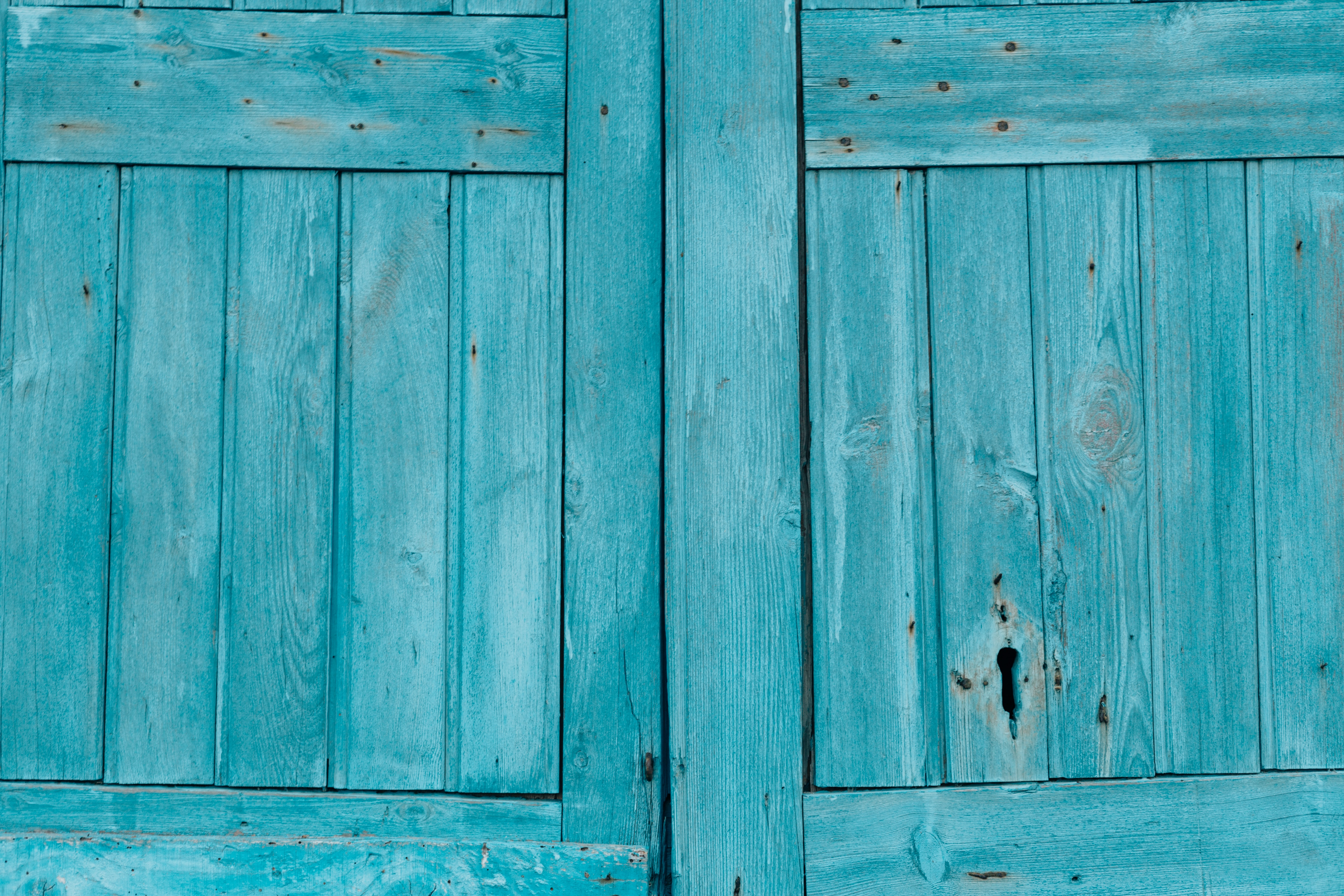 A blue wooden door texture background, taken in Malfa, Sicily, Italy