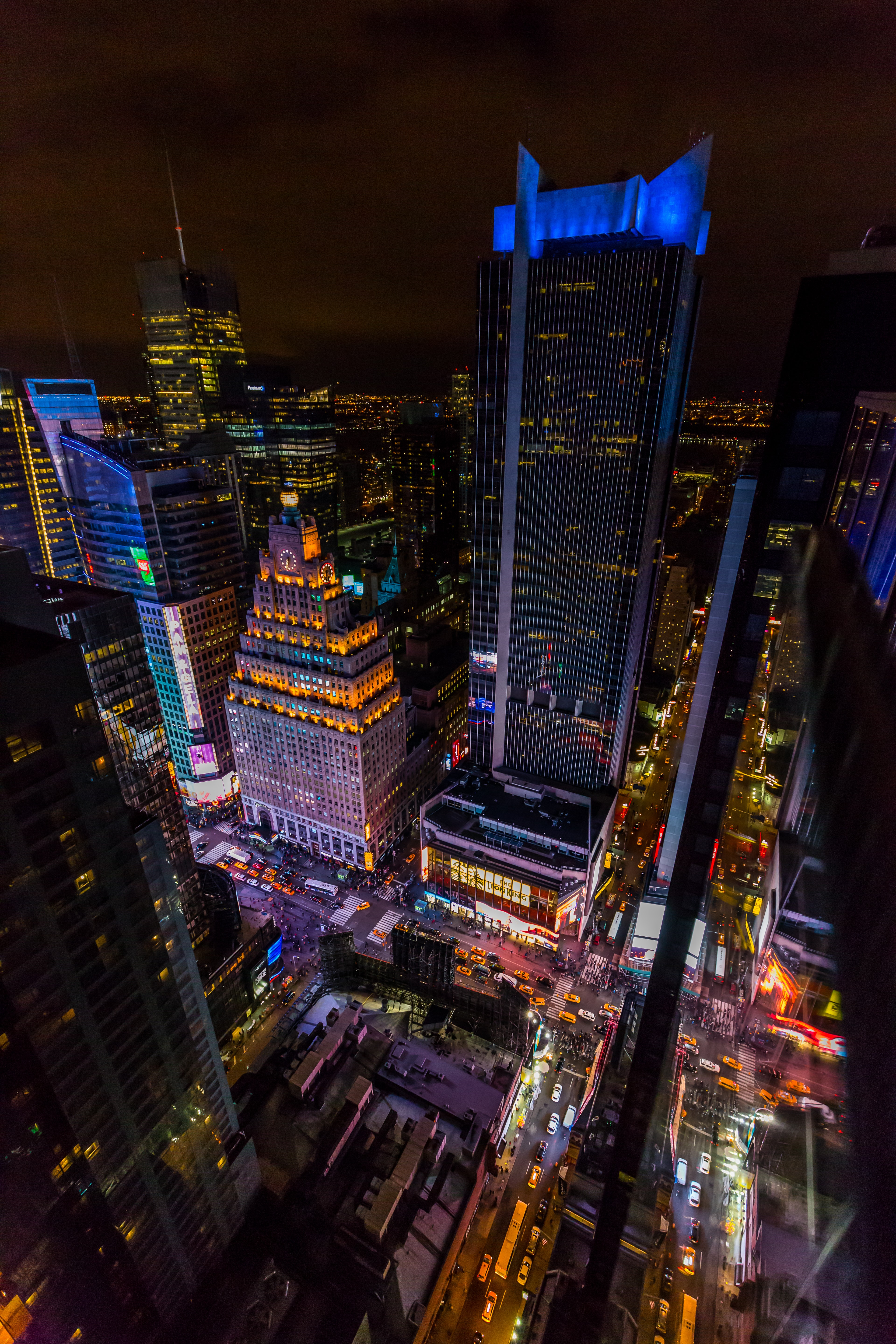 A high shot of neon-soaked skyscrapers in New York at night