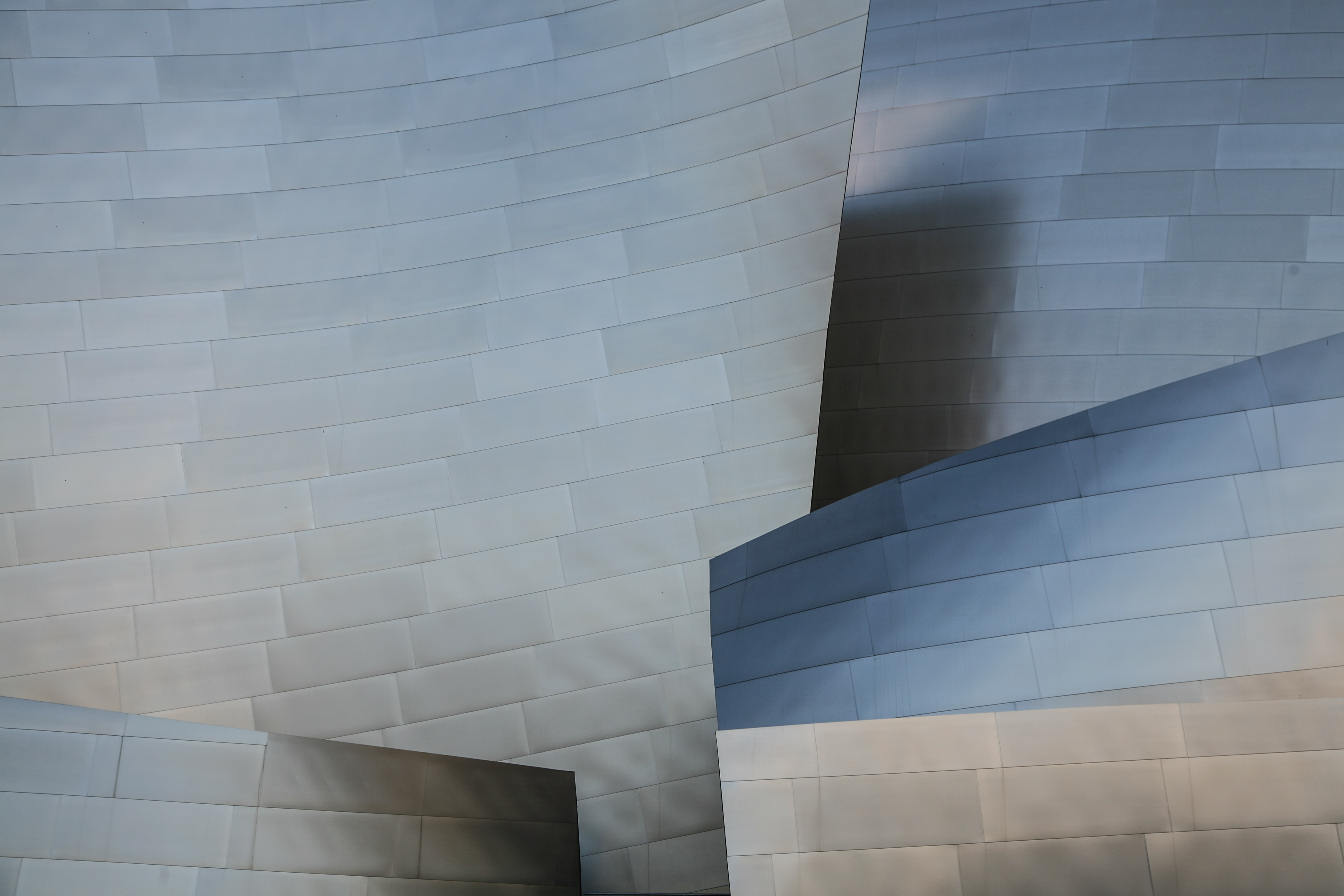 Glossy steel panels in the modern facade of Walt Disney Concert Hall in Los Angeles