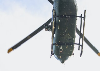 green and brown helicopter photography
