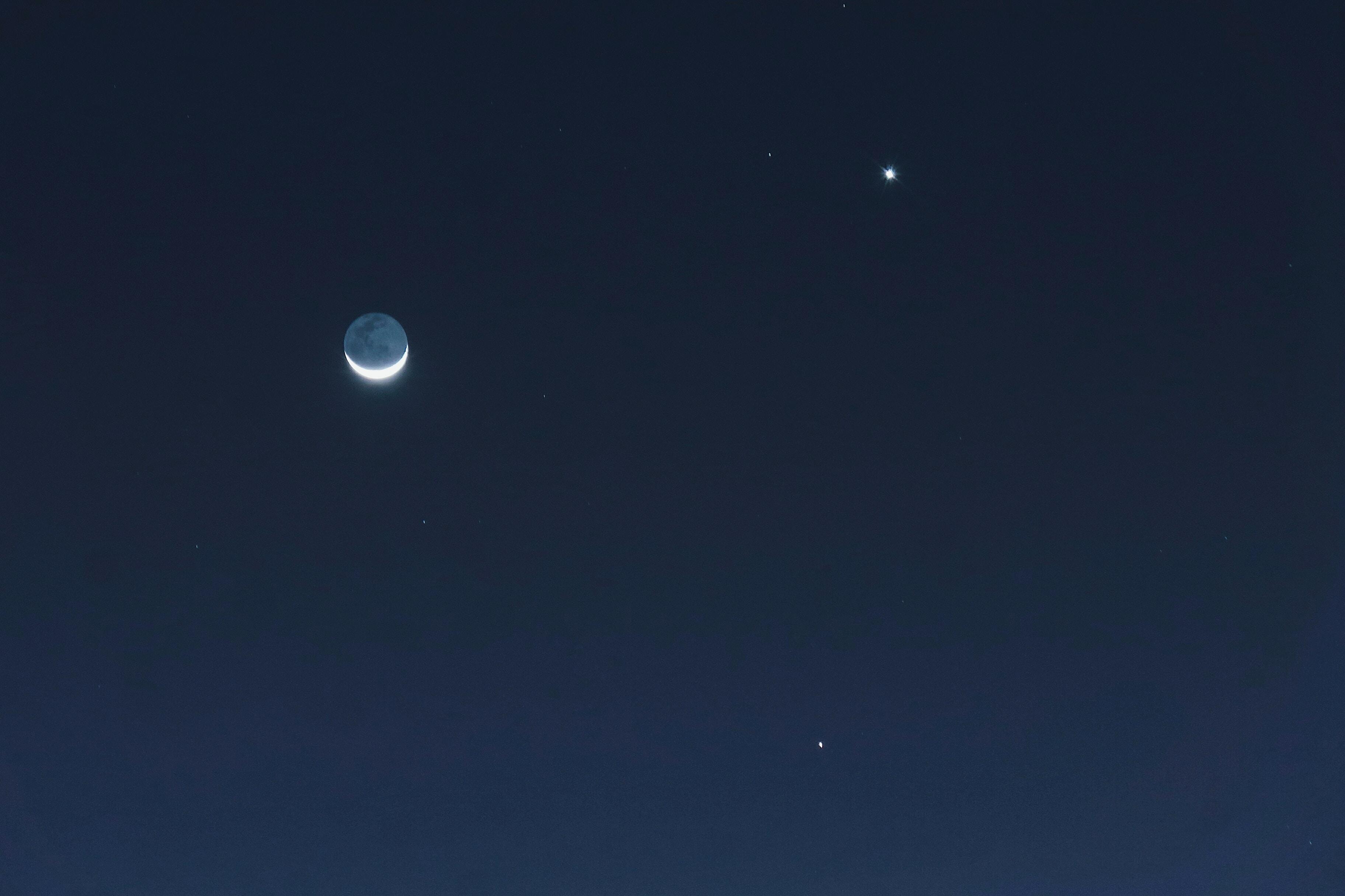 A dark blue sky with a lunar eclipse.