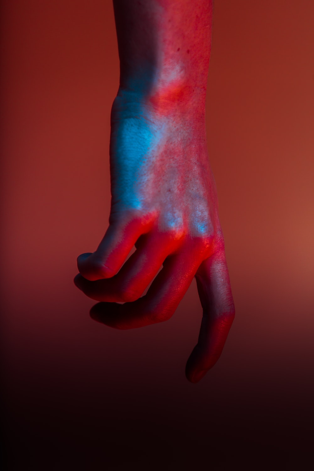shallow focus photography of hand with red paint