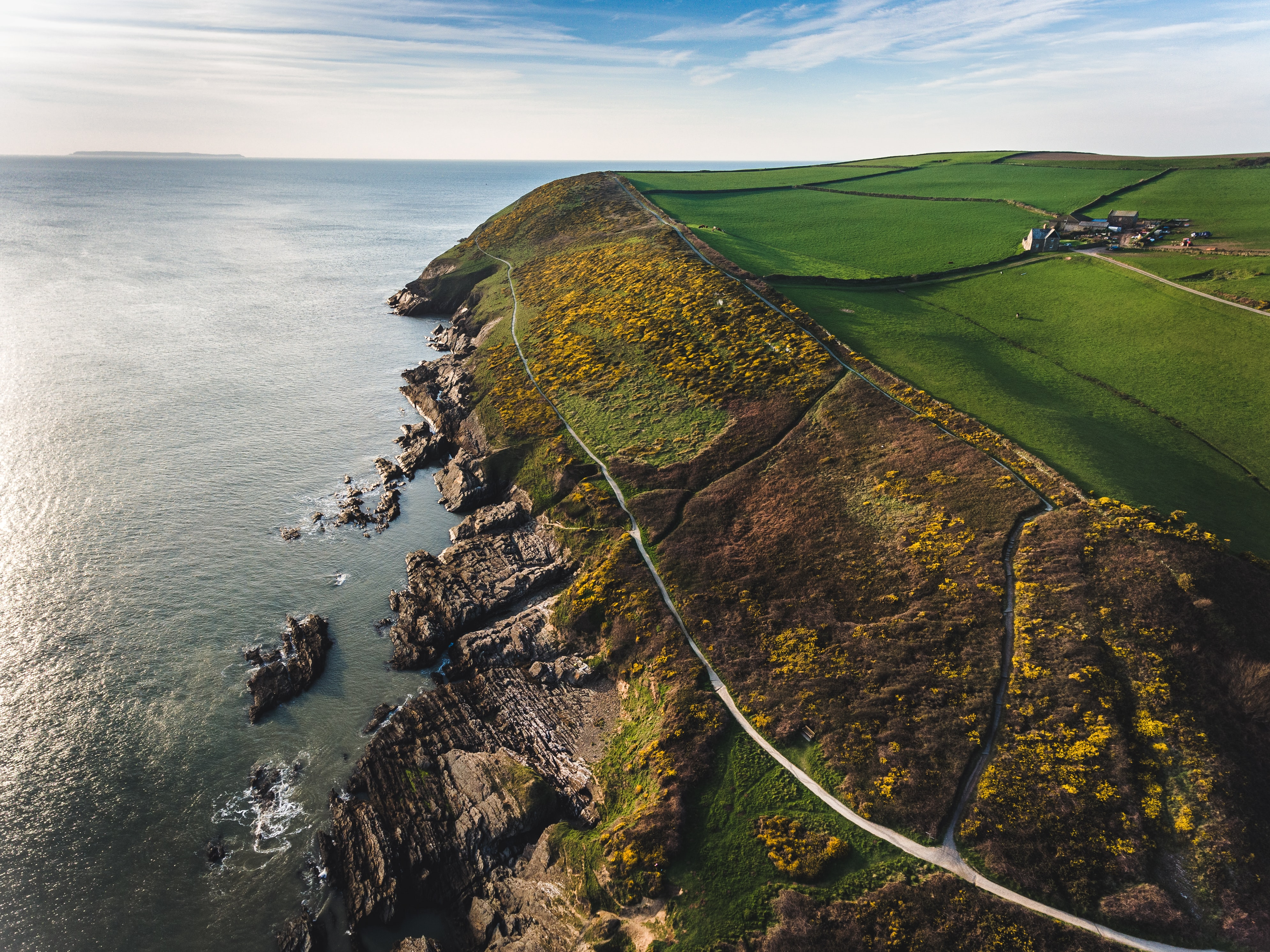 aerial view photography of cliff near body of water
