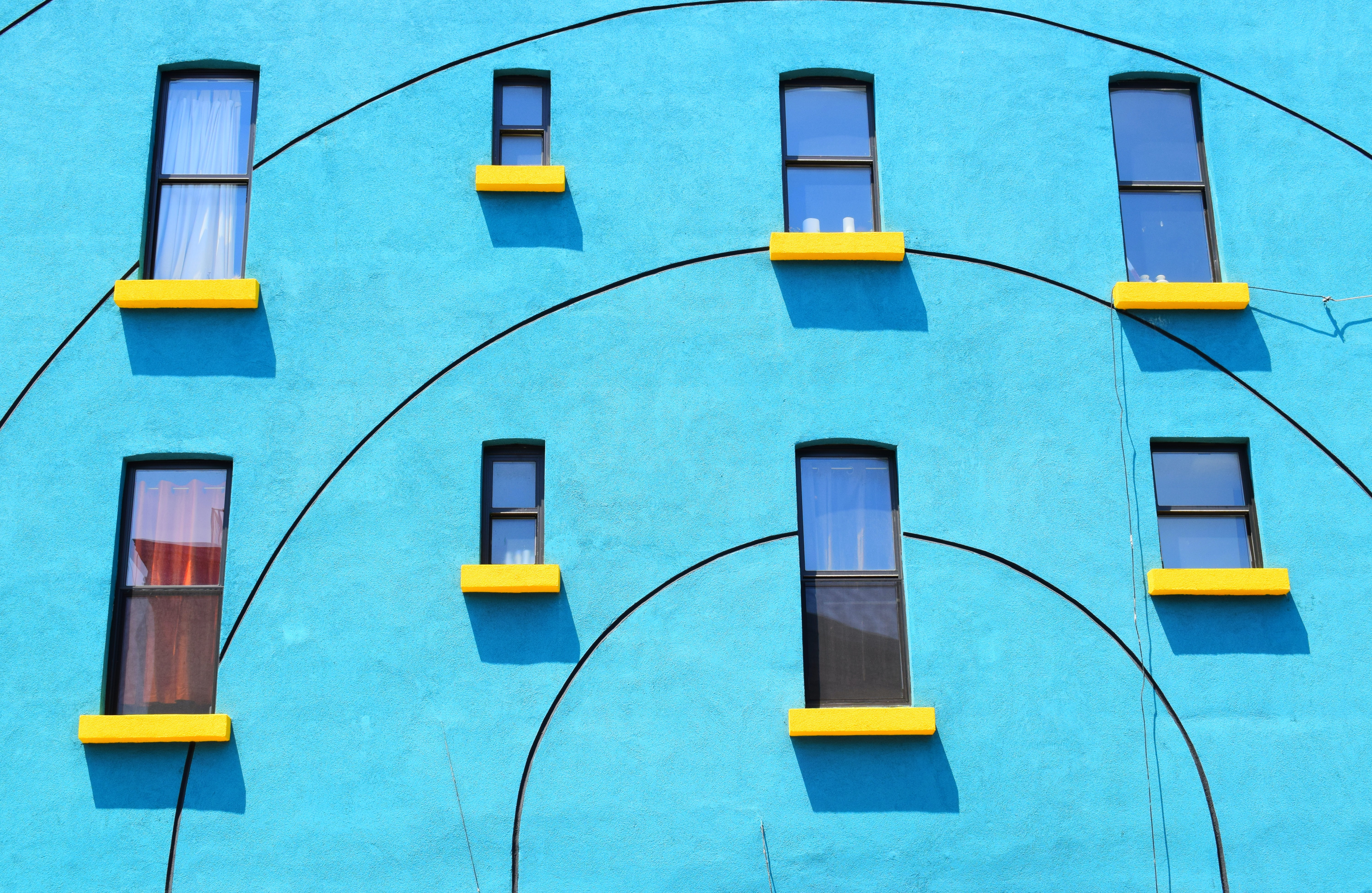 blue painted wall with eight windows