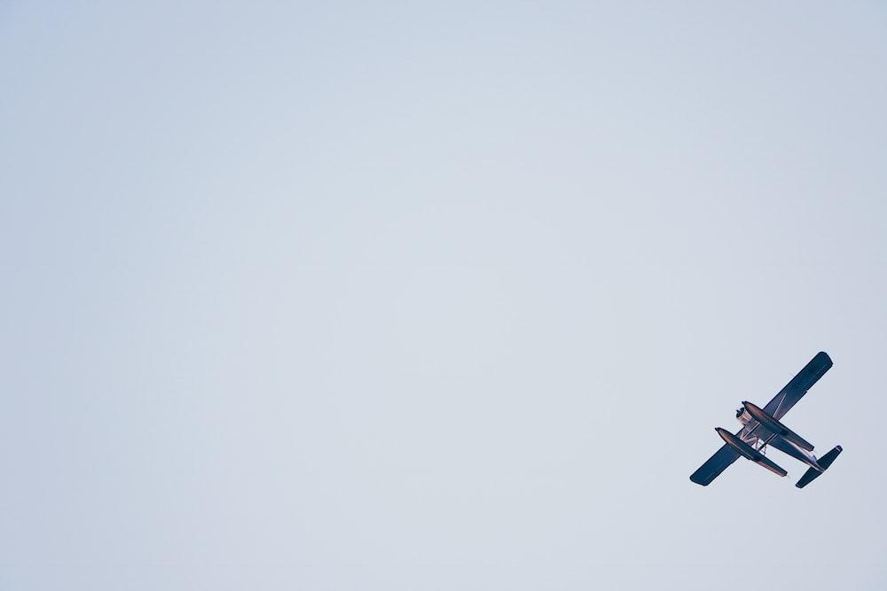 biplane on white sky