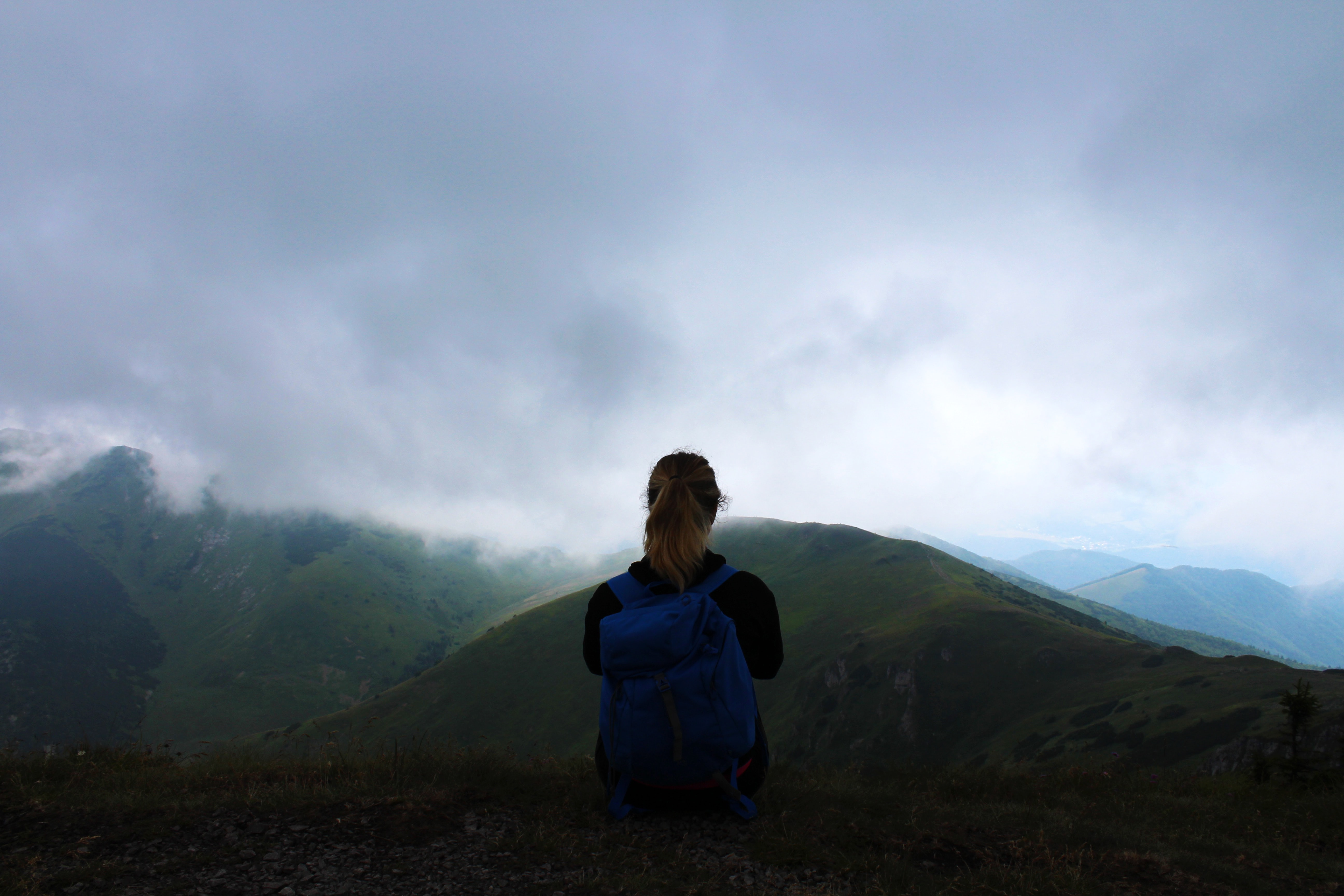 woman facing mountain with sea of clouds