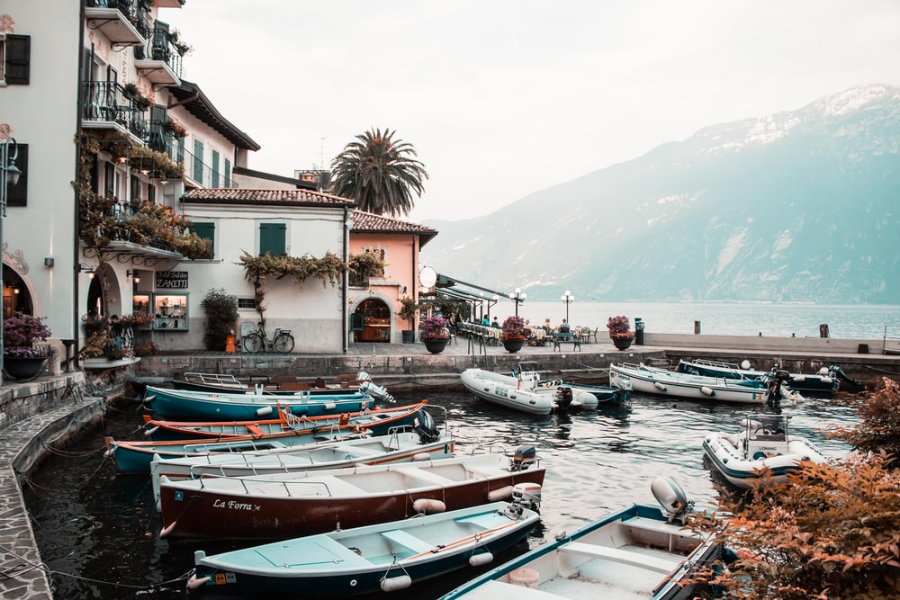 boats on body of water near houses