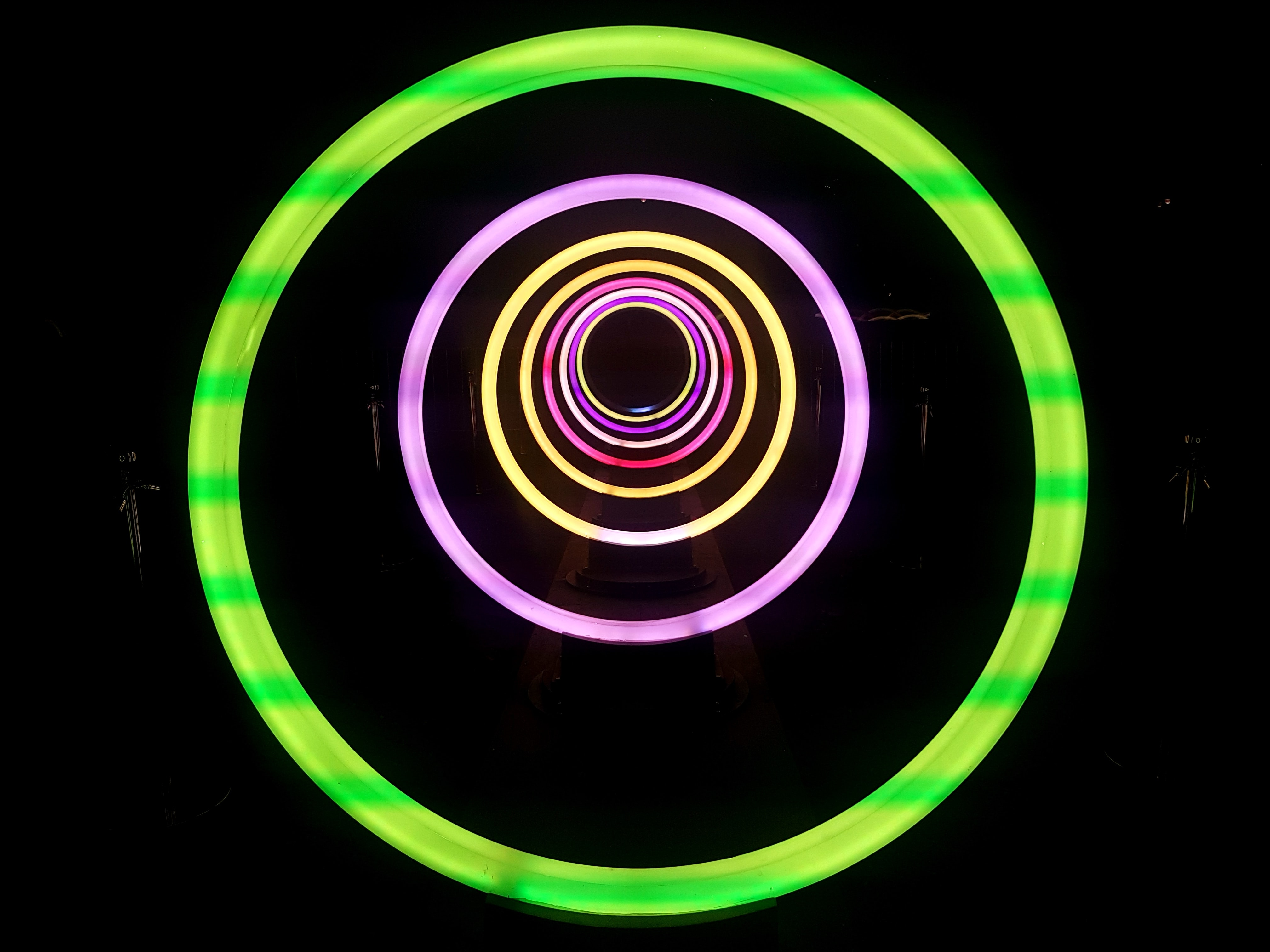 A tunnel surrounded by colorful circle light strips, taken in Toronto