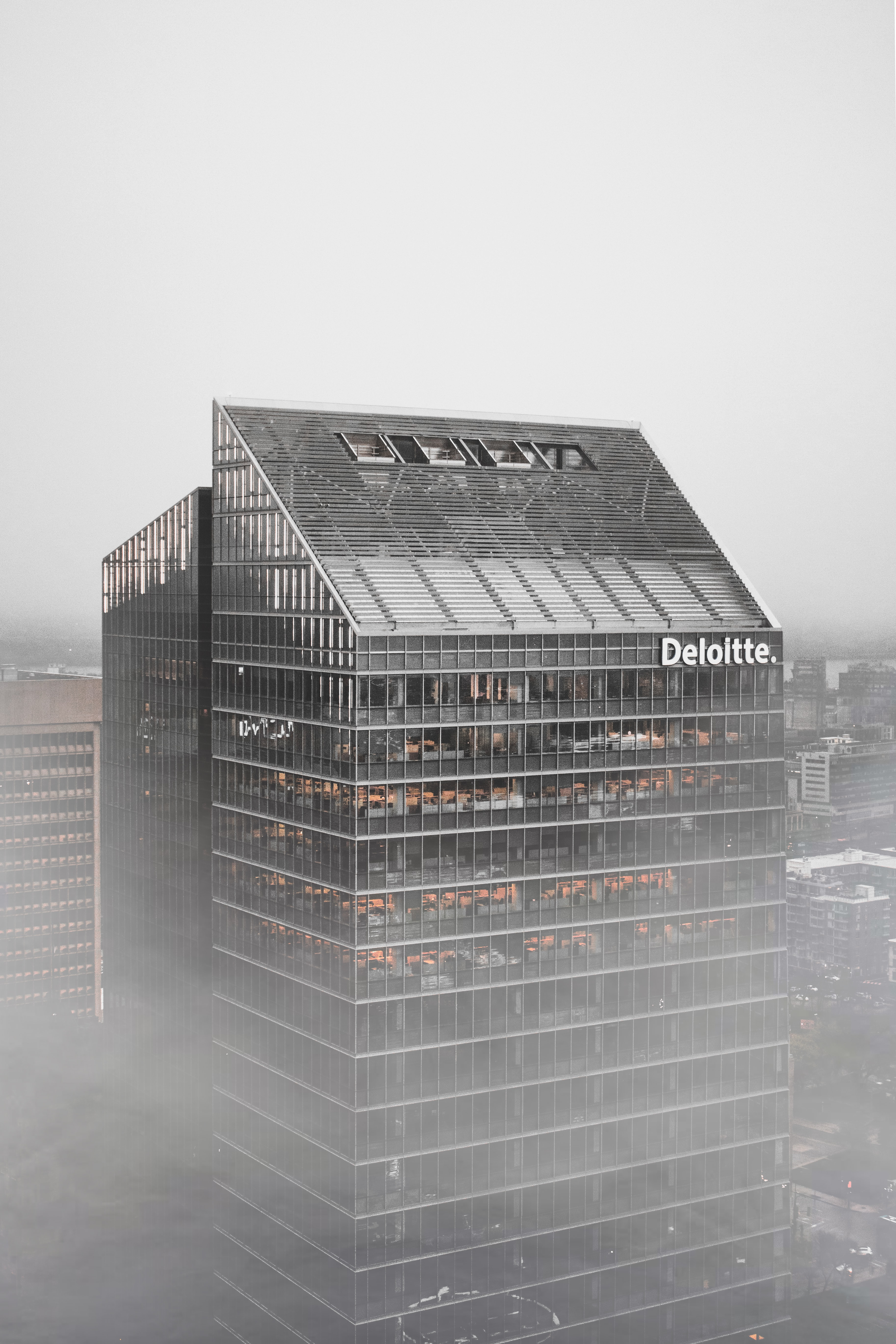 gray Deloitte building during daytime