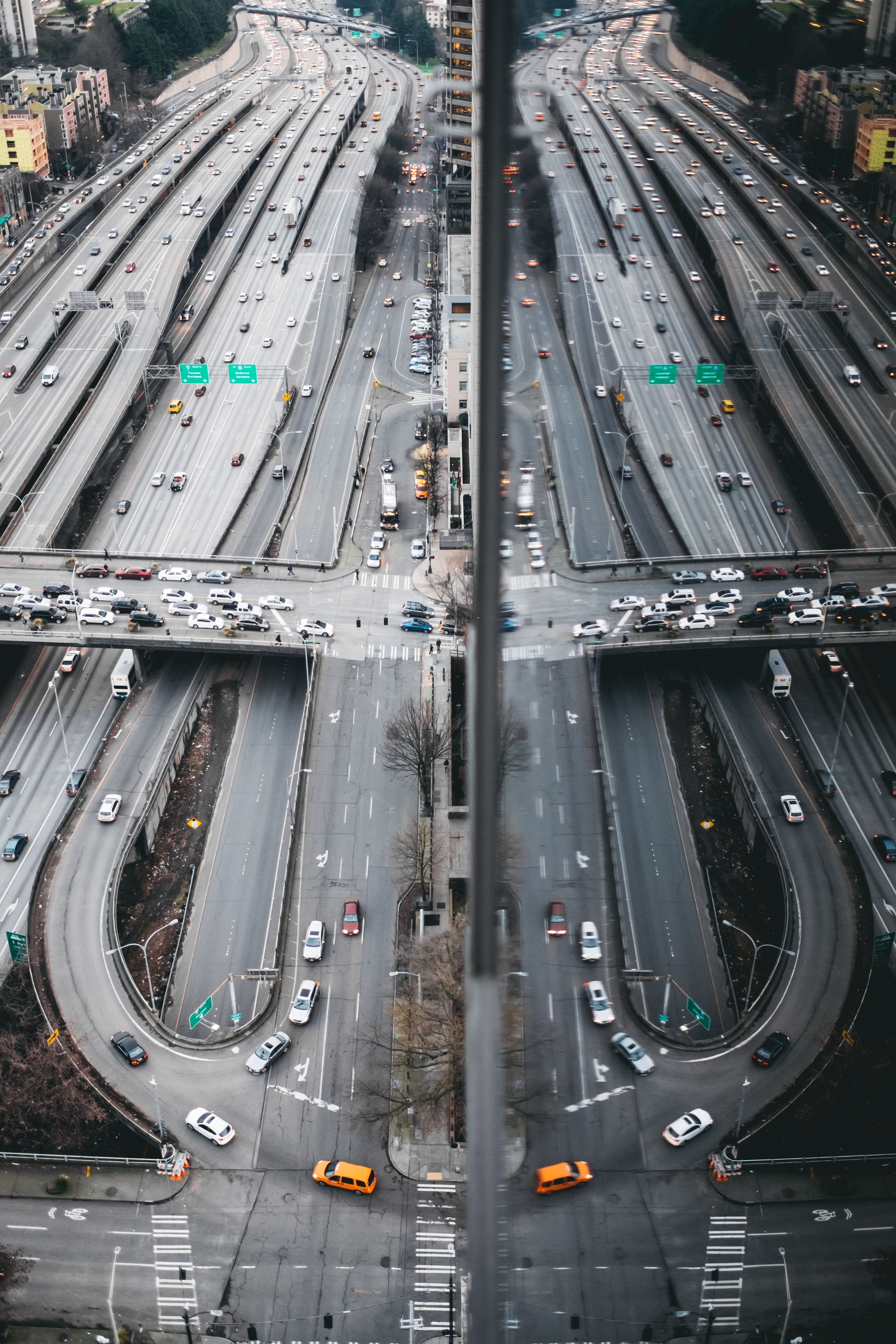 Highway roads reflect in buildings to form loops and lines