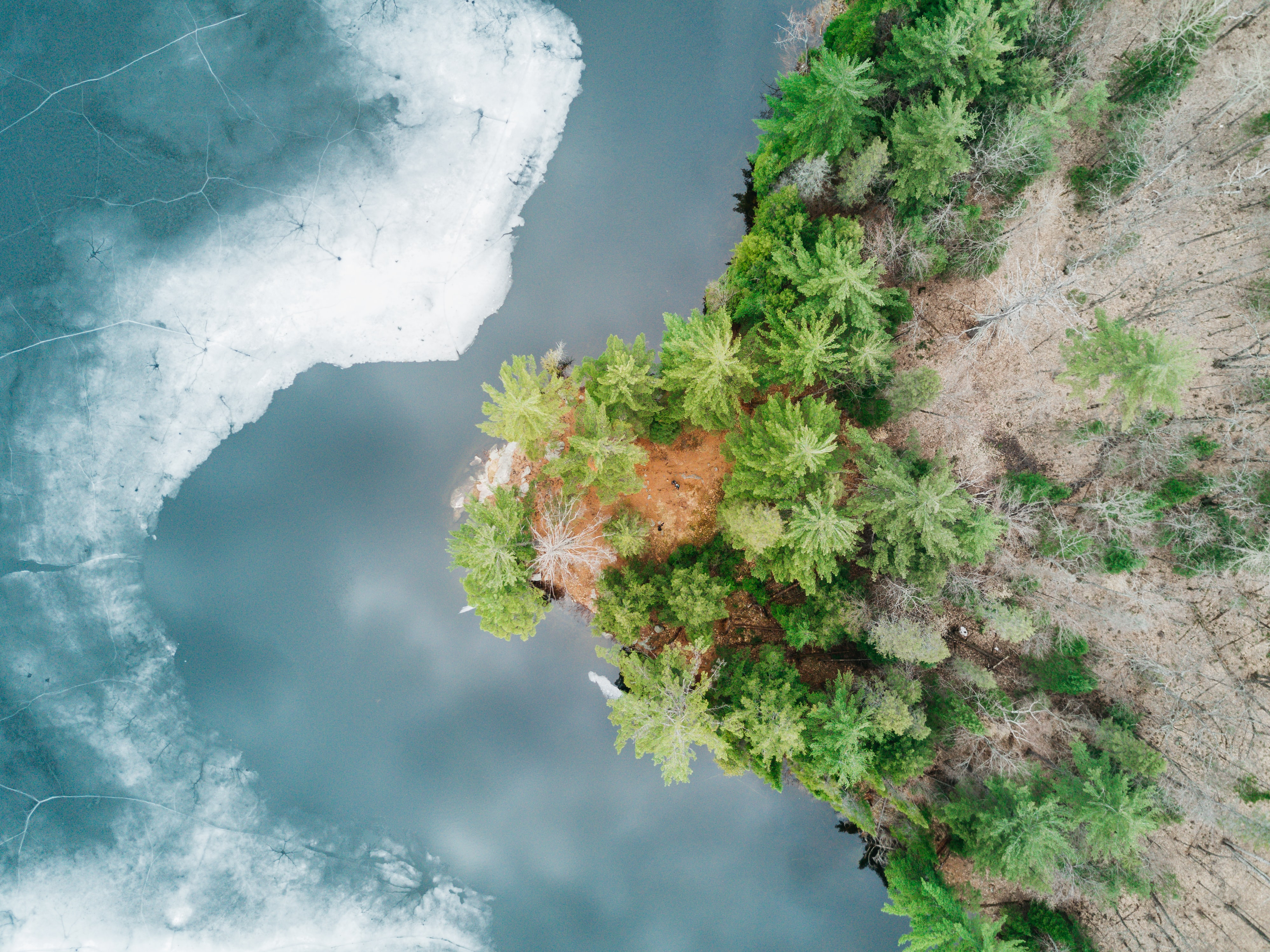 aerial photography of cliff beside ocean