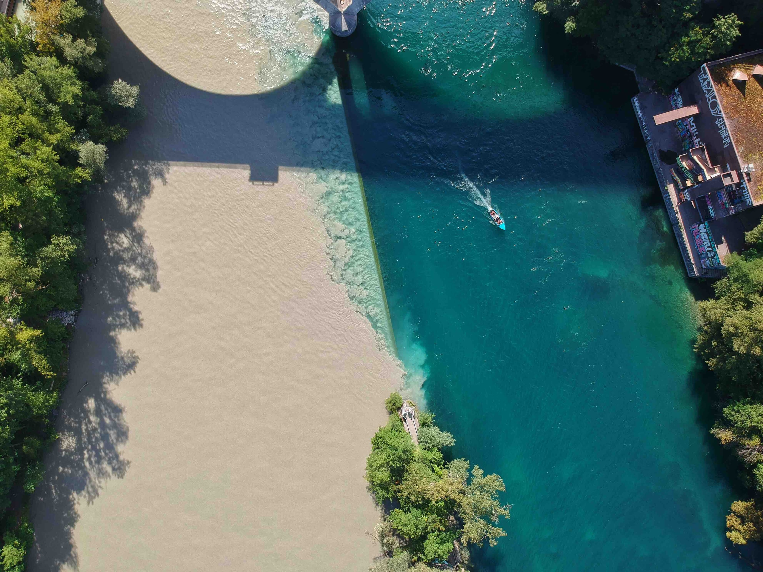 aerial view of boat sailing near house
