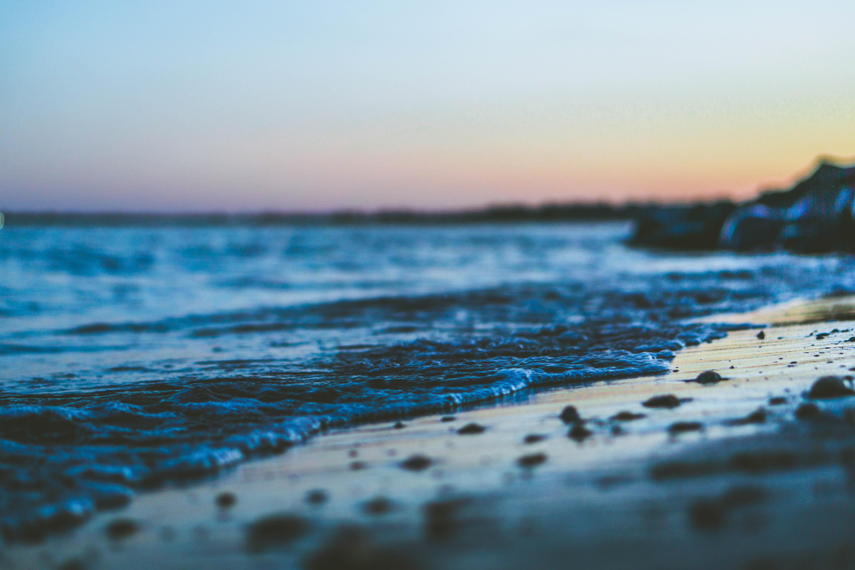 Macro shot of a sea foam washing on Walnut sand beach after sunset