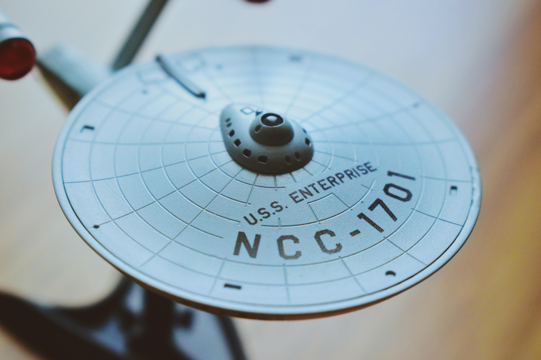 round gray USS Enterprise aircraft scale model