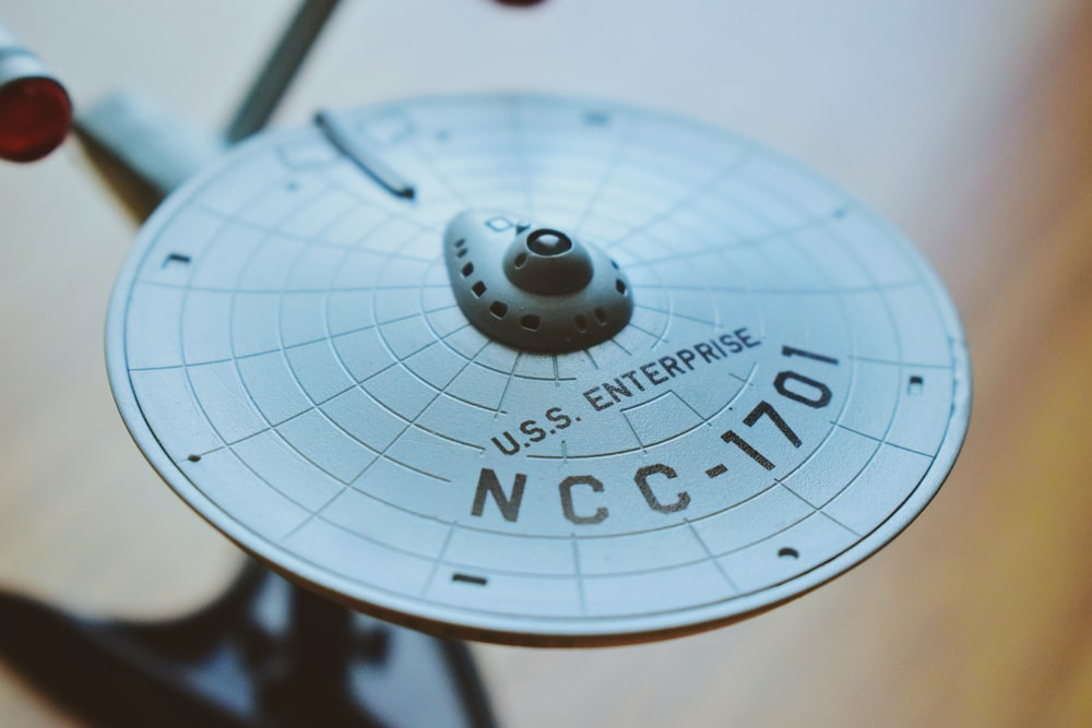round gray USS Enterprise aircraft scale model