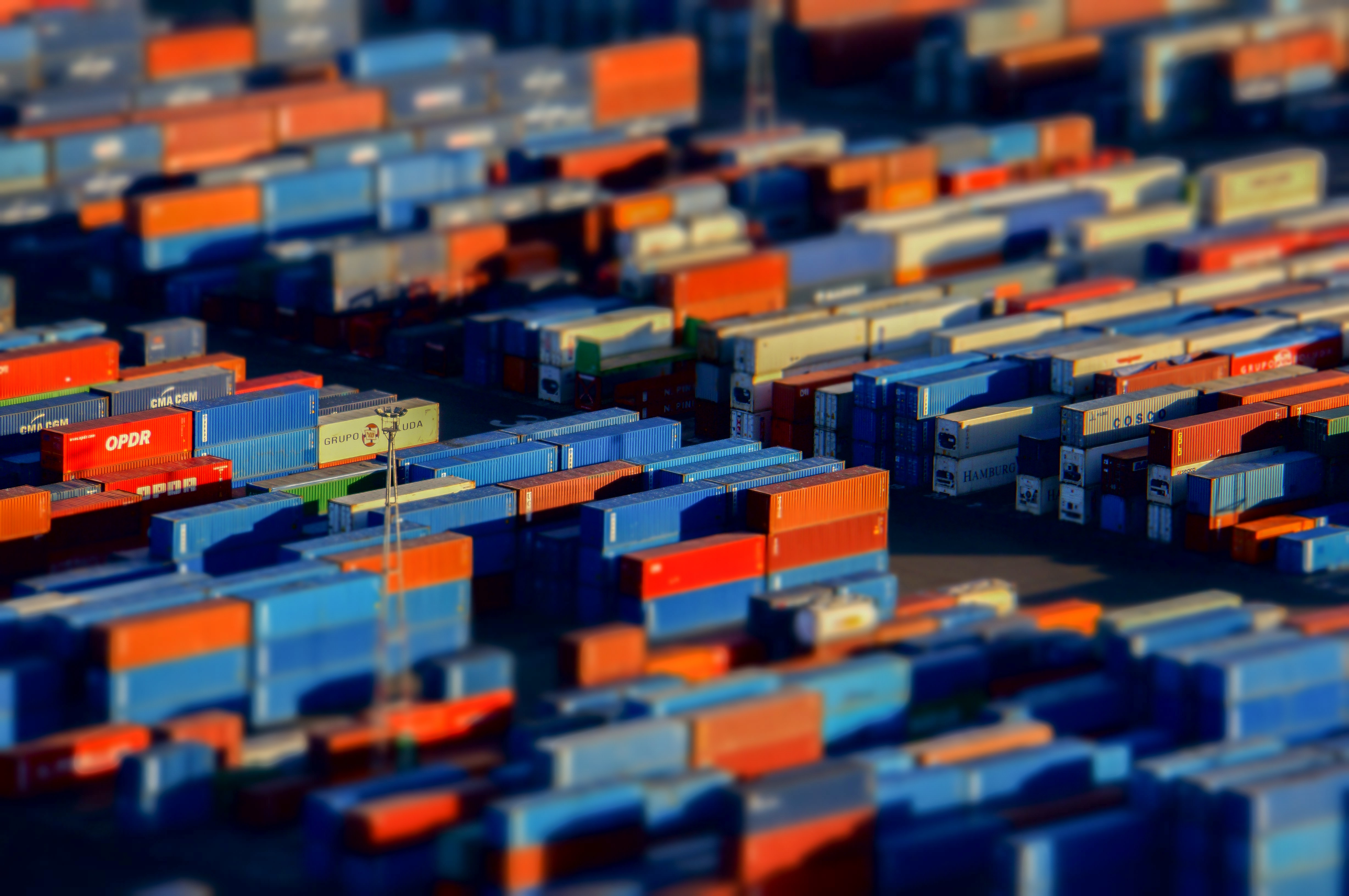 Clusters of shipping containers arranged in rows as seen in Barcelona.