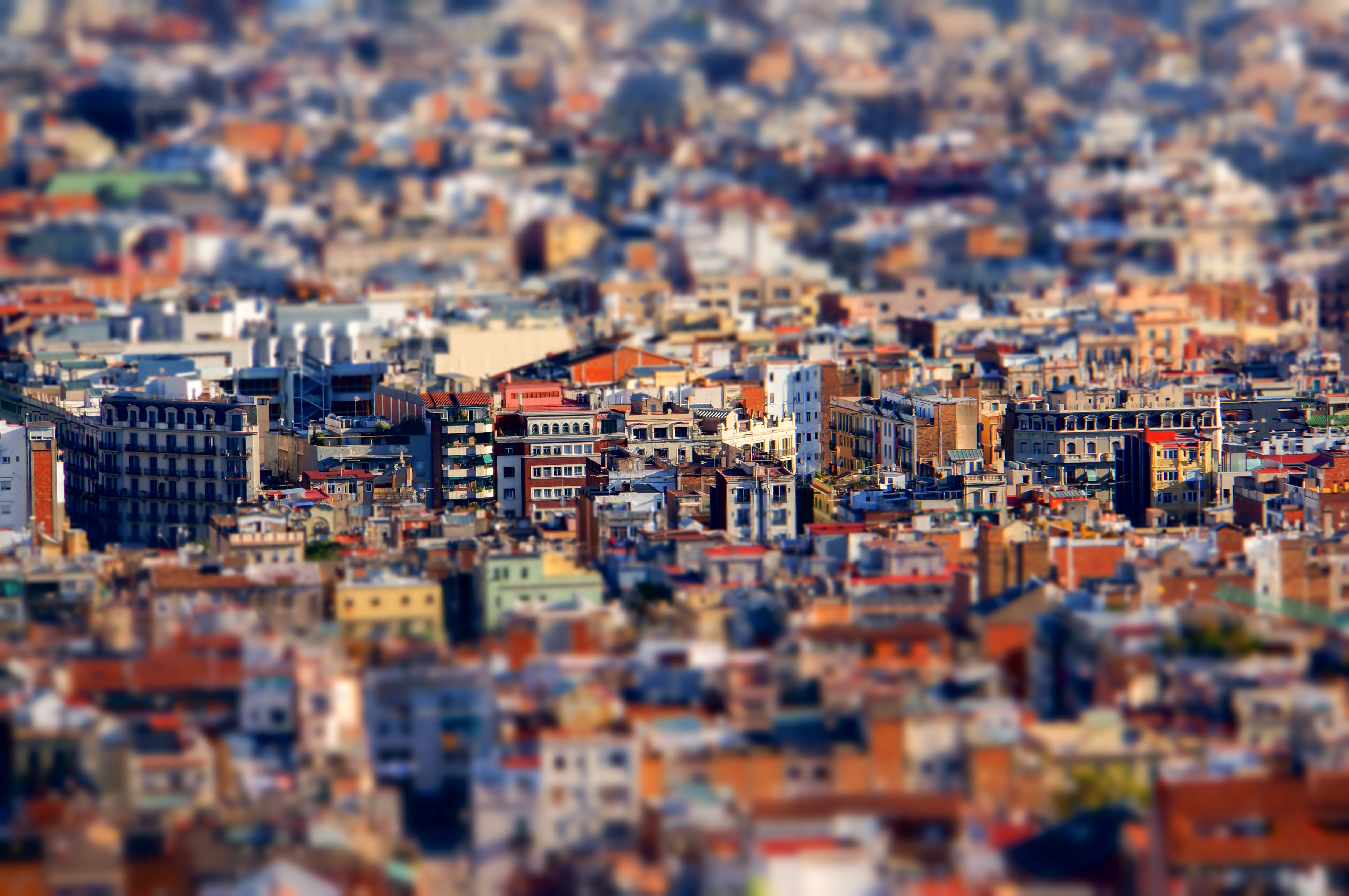 Tilt-shift aerial shot of colorful architecture and historic buildings in Barcelona
