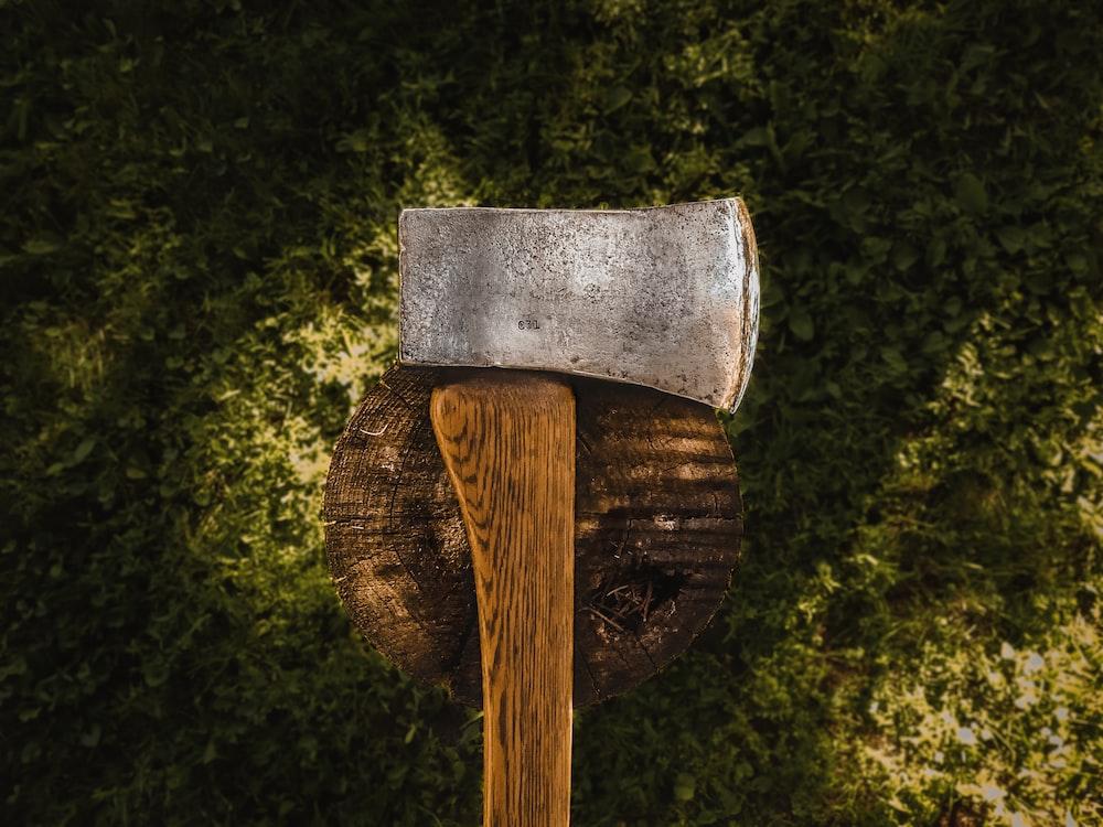 brown axe on brown wood log during daytime