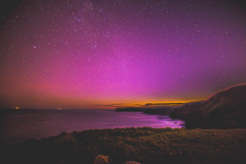 landscape photo of body of water under starry sky