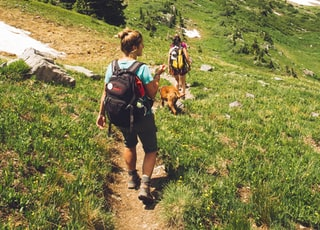 woman walking down the hill at daytime
