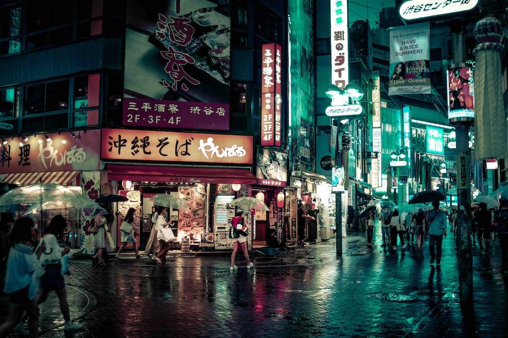 people walking near buildings at night