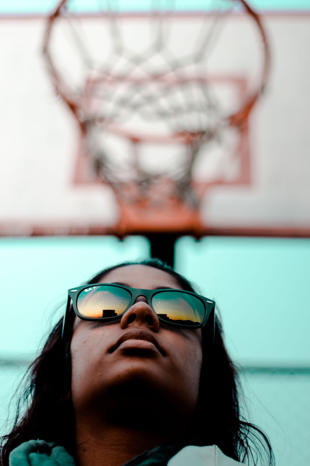 person wearing black Ray-Ban Wayfarer sunglasses with black frames in worm's eyeview photography during daytime