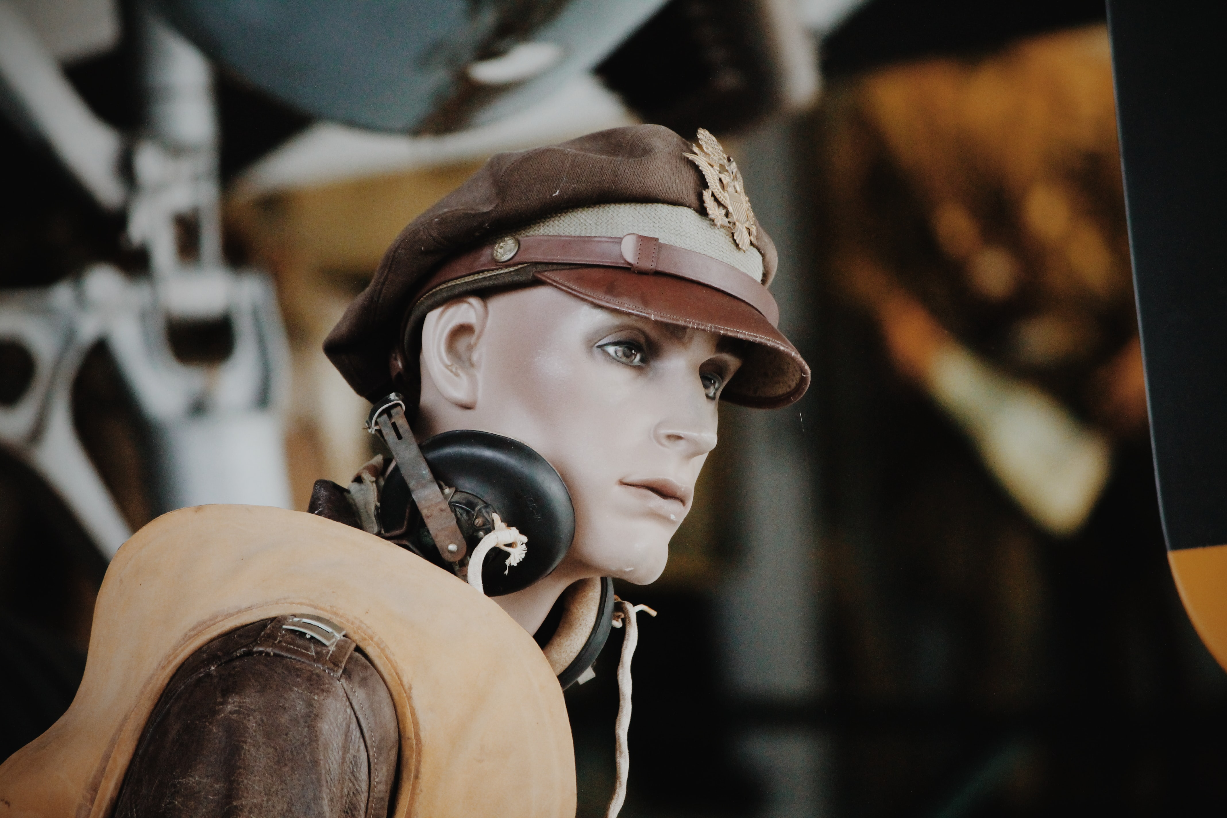 Creepy mannequin posed in a vintage pilot outfit