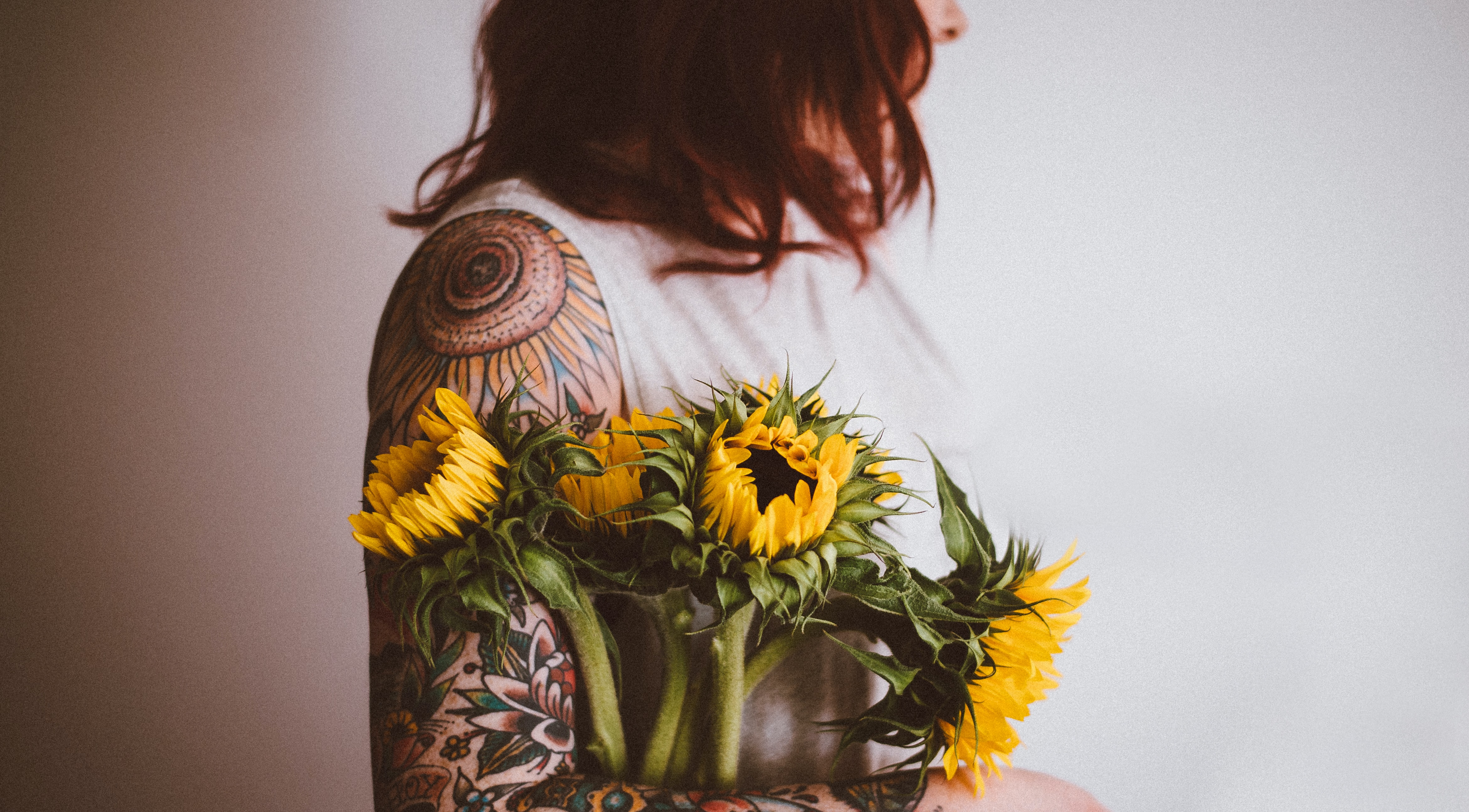 woman holding Sunflower flowers photography